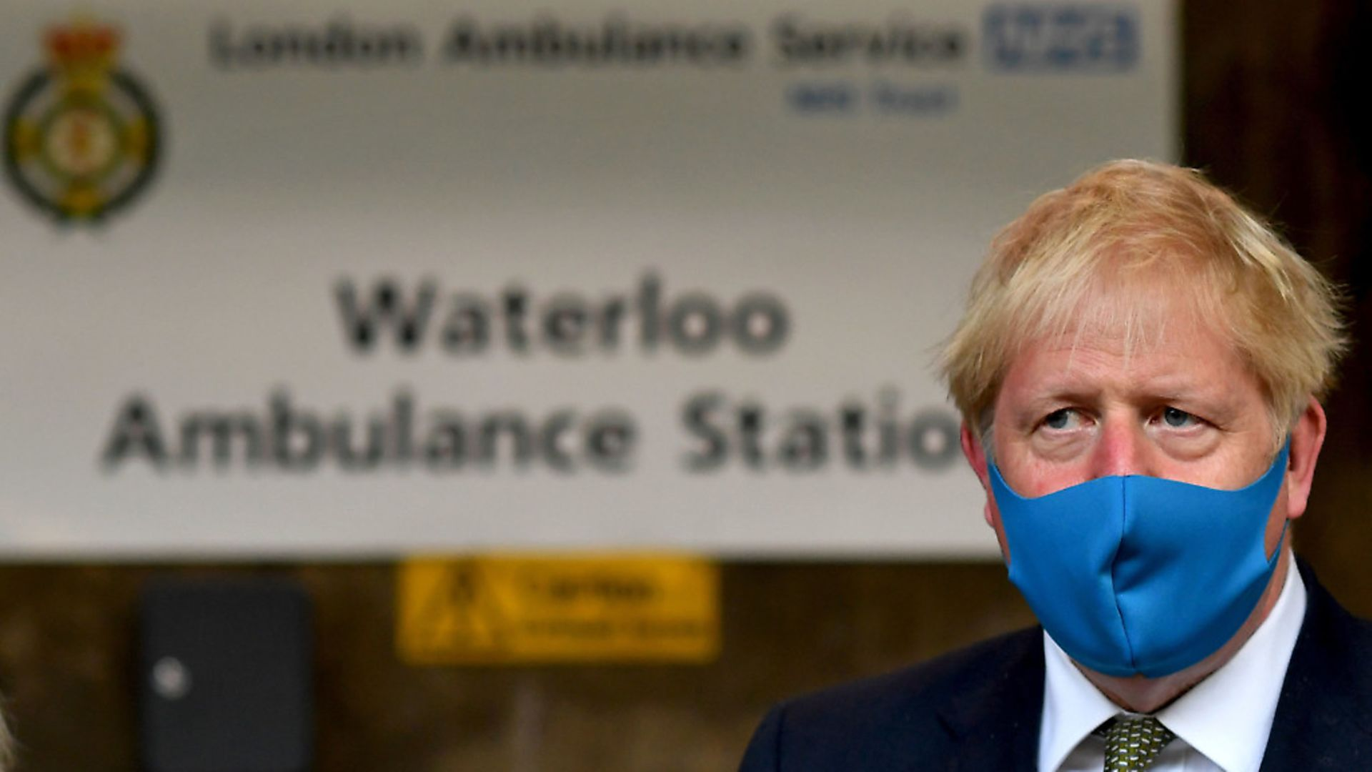 Prime Minister Boris Johnson, wearing a face mask, during a visit to the headquarters of the London Ambulance Service NHS Trust. Photograph: Ben Stansall/PA Wire - Credit: PA