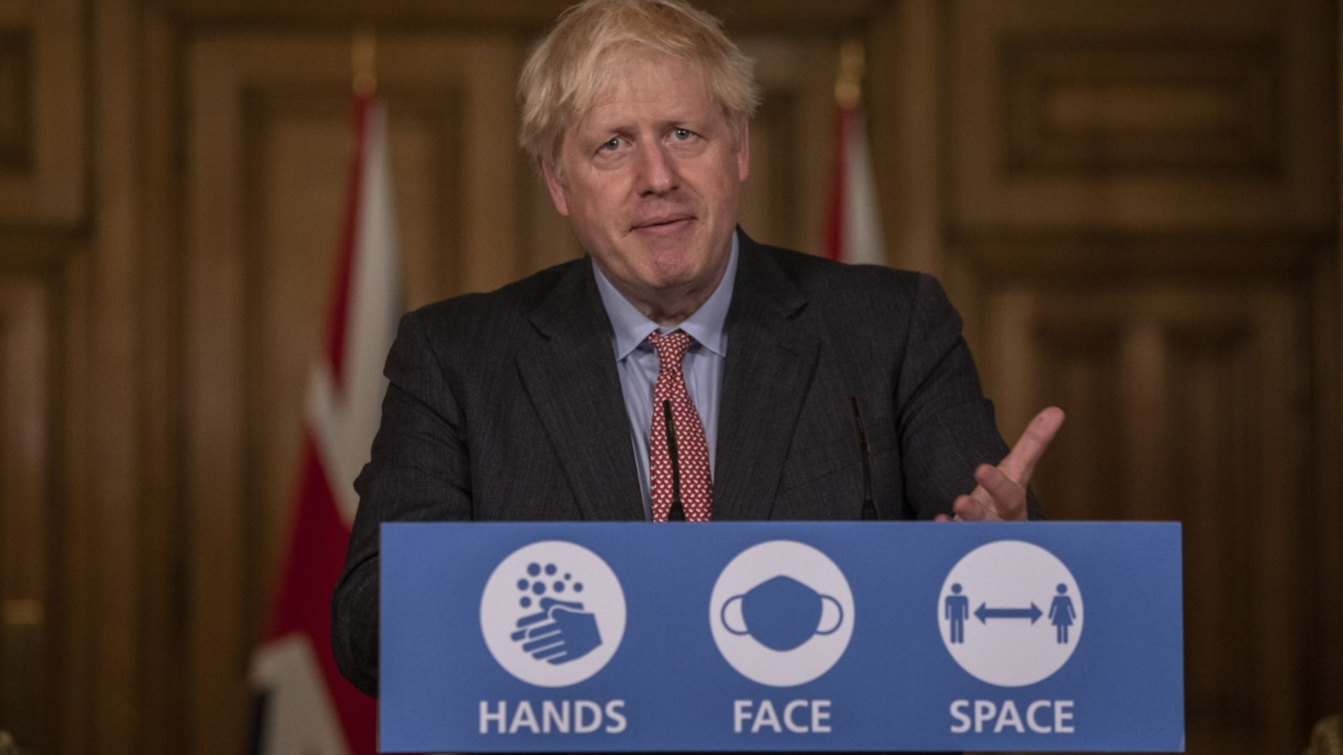 Boris Johnson stands behind the podium at 10 Downing Street - Credit: PA Wire