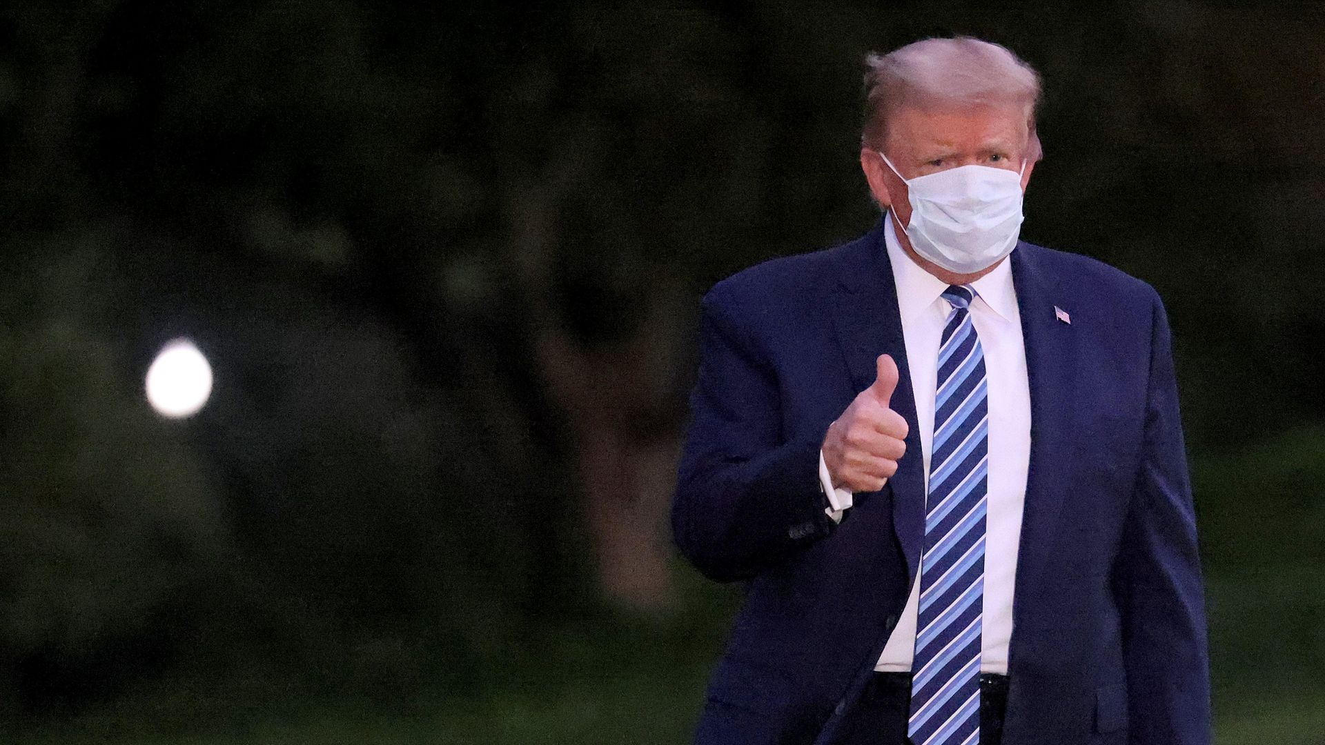 Donald Trump gestures upon return to the White House after his bout of coronavirus - Credit: Getty Images