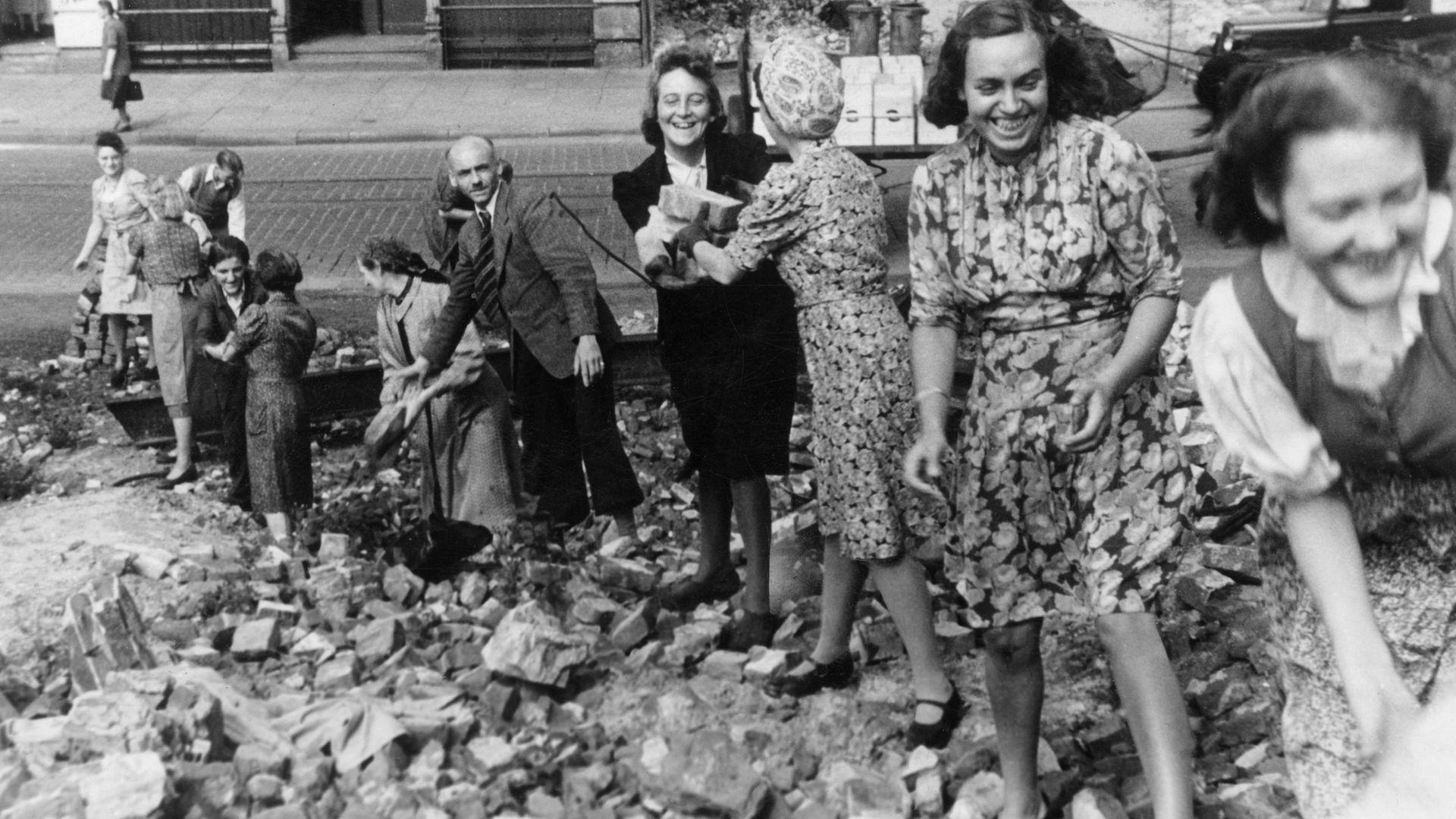 Trümmerfrauen - literally 'rubble' women - at work as Germany's post-war rebuilding operation begins - Credit: Getty Images