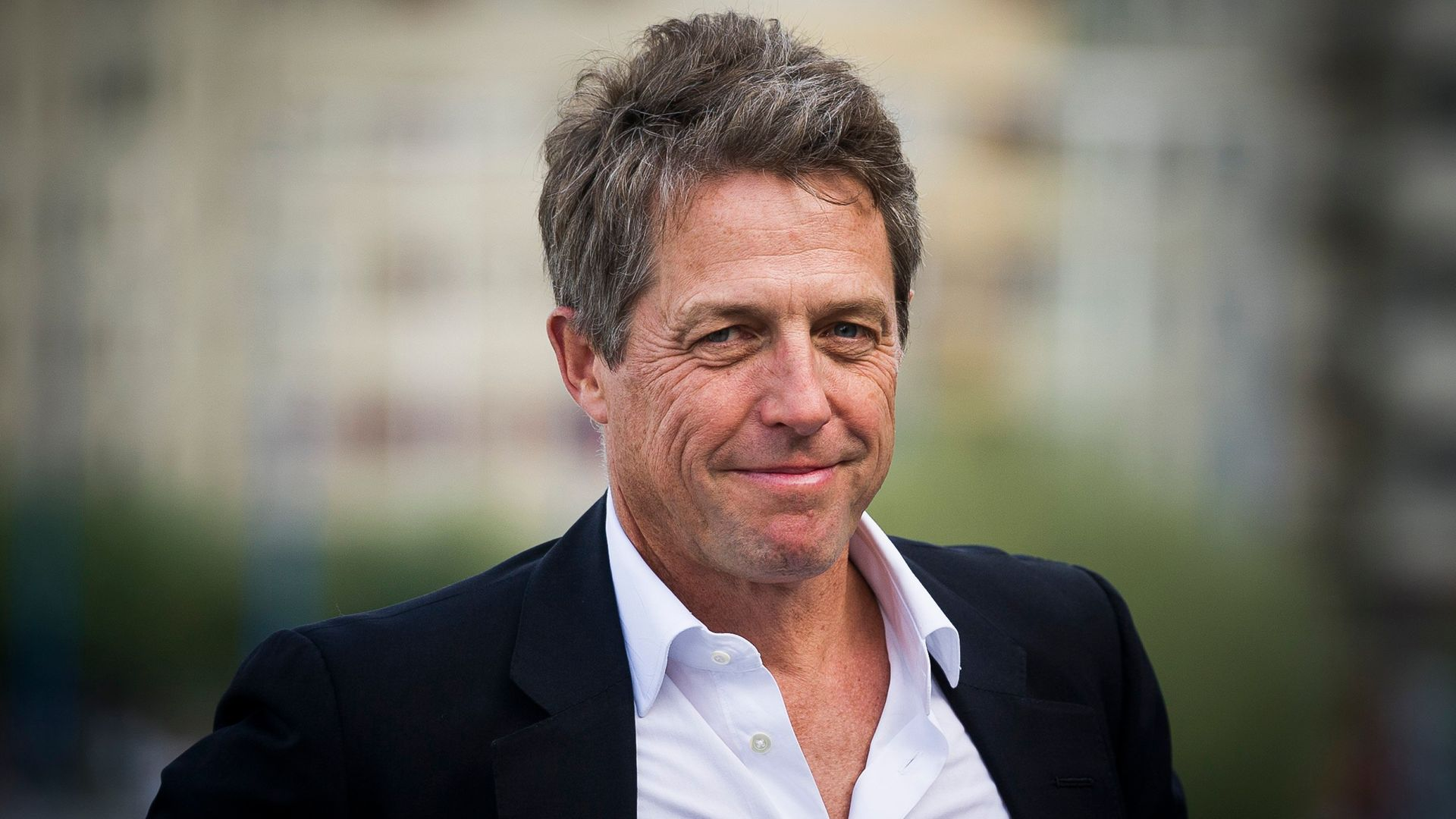 Hugh Grant attends a photocall for 'Florence Foster Jenkins (2016)' at the San Sebastian Film Festival - Credit: Getty Images