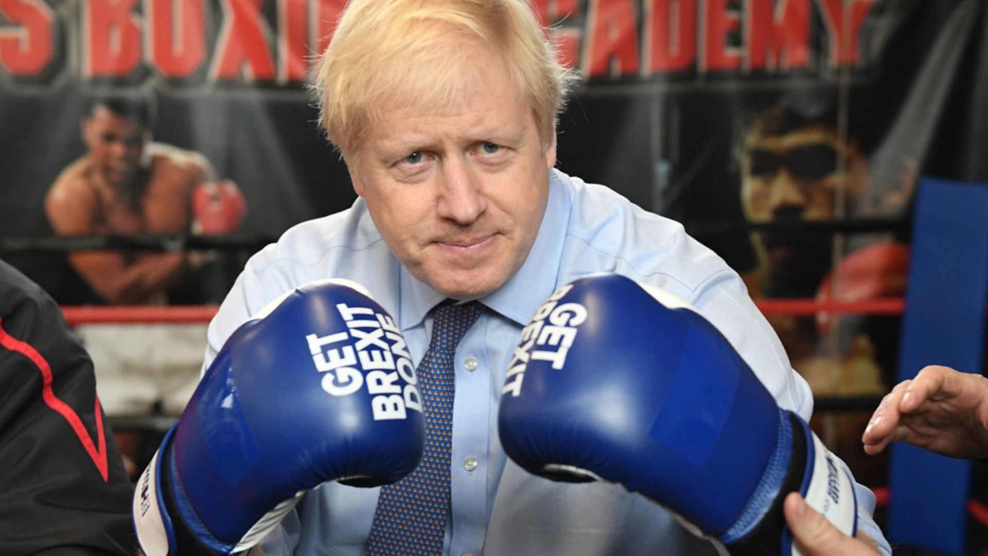 Boris Johnson in 'get Brexit done' gloves - Credit: PA