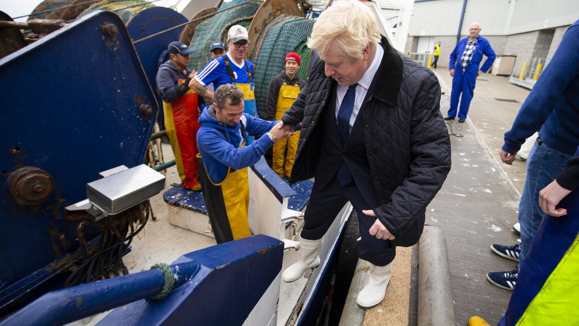 Prime Minister Boris Johnson on the Opportunis IV fishing trawler, during a visit to Peterhead fish market near Aberdeen - Credit: PA