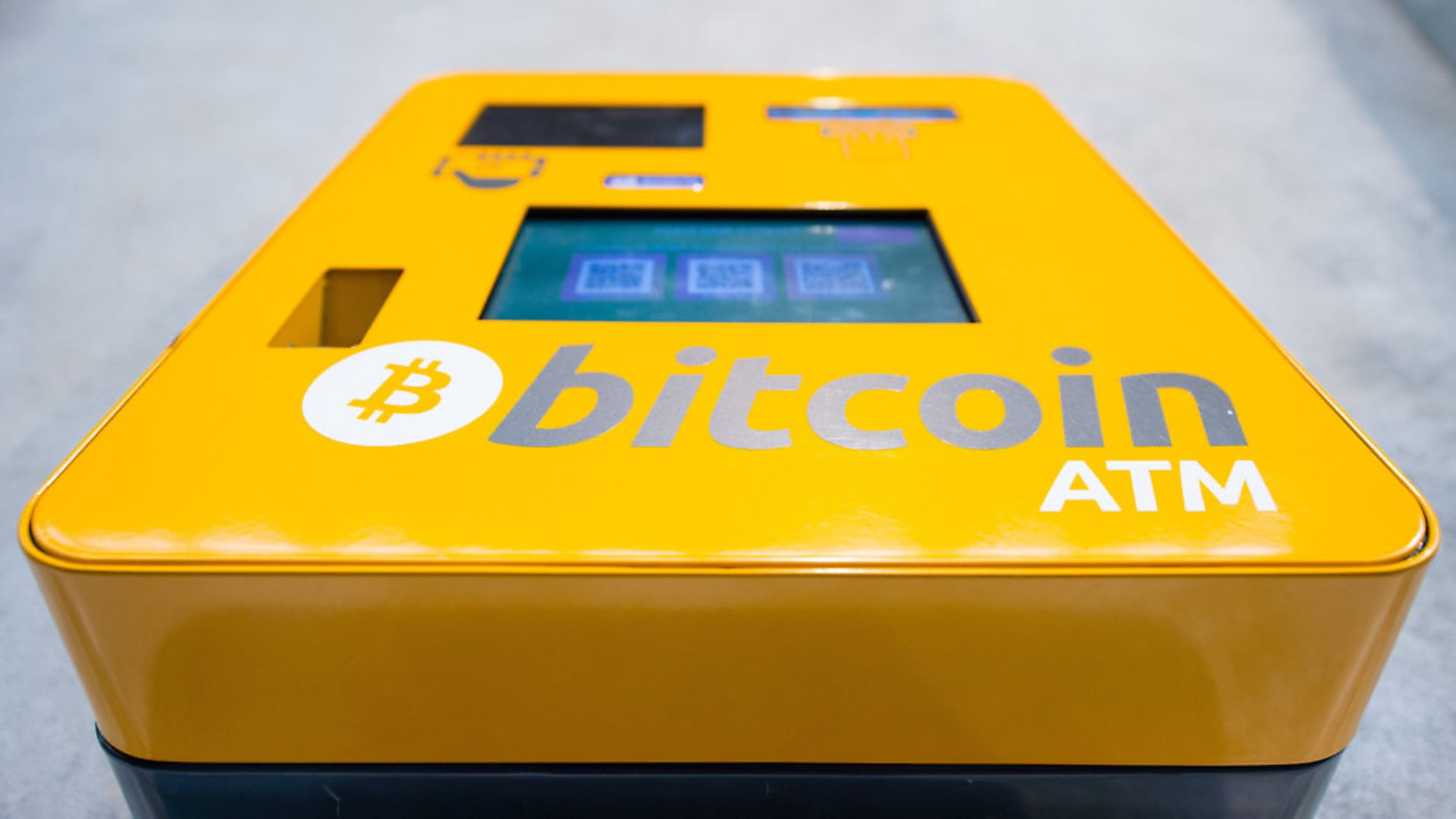 A bitcoin ATM. Each bitcoin is now worth nearly ,000. Picture: Dominic Lipinski/PA Wire - Credit: PA Archive/PA Images