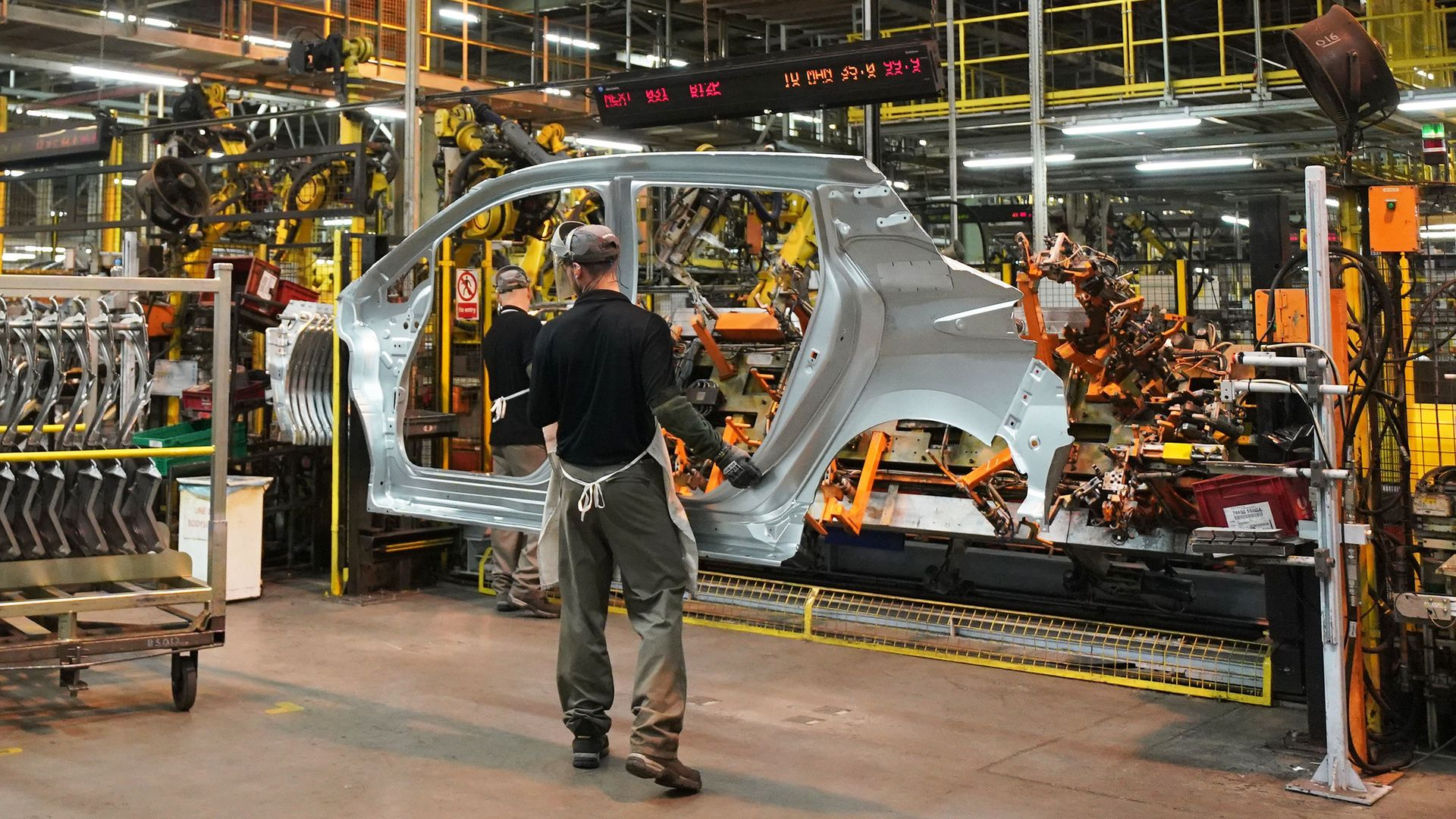 Worker on the production line at Nissan's factory in Sunderland. - Credit: PA