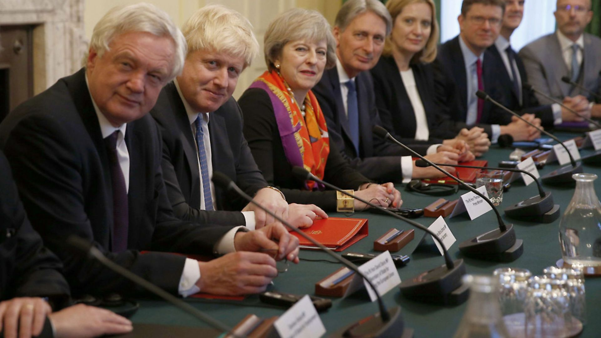 British Prime Minister Theresa May with members of her cabinet (Photo: PETER NICHOLLS/AFP/Getty Images) - Credit: AFP/Getty Images
