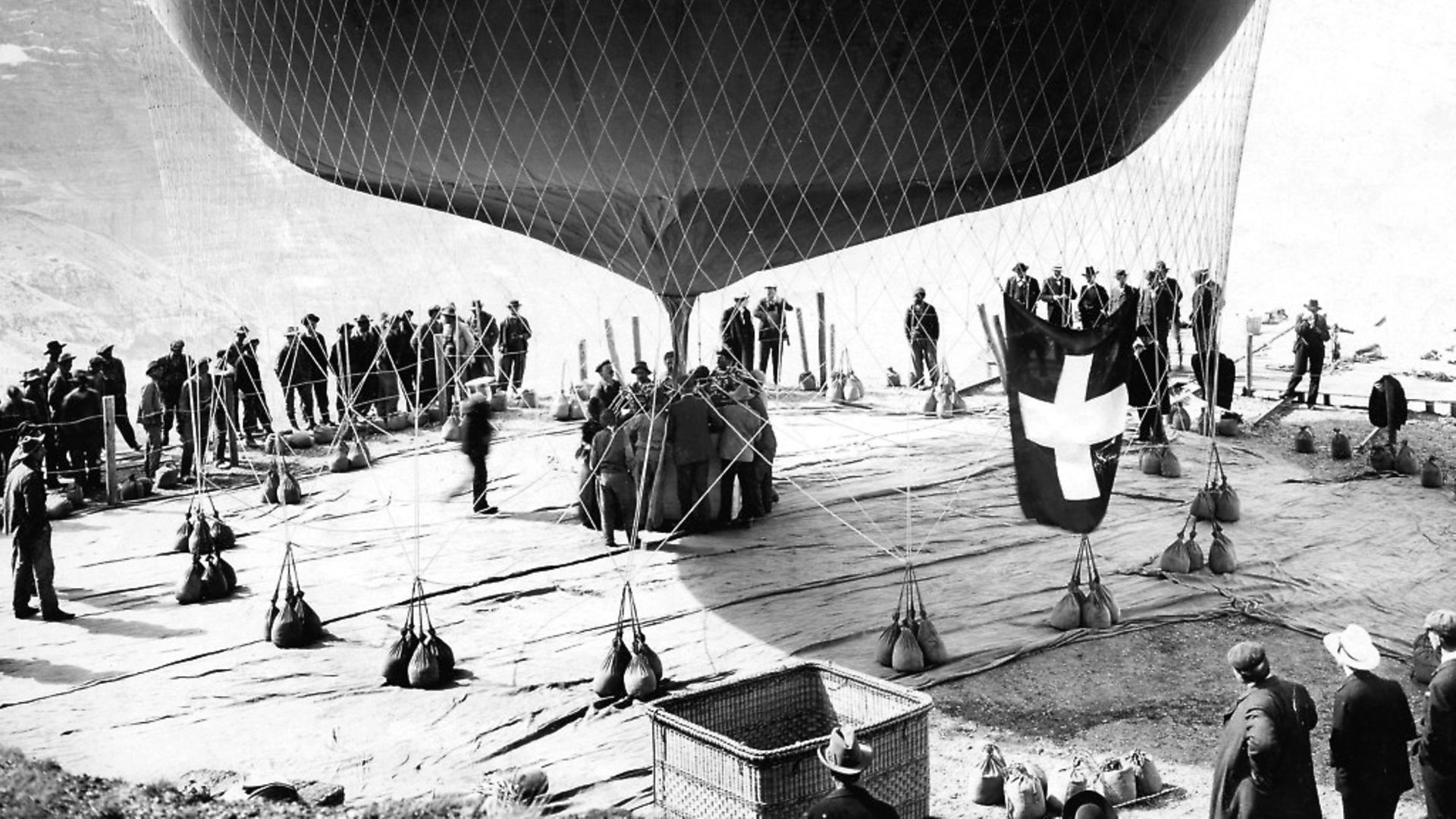 Start of a balloon ride over the Alps, filling a trial balloon, published by Berliner Illustrirte Zeitung. Picture: Eduard Spelterini. - Credit: ullsteinbild / TopFoto