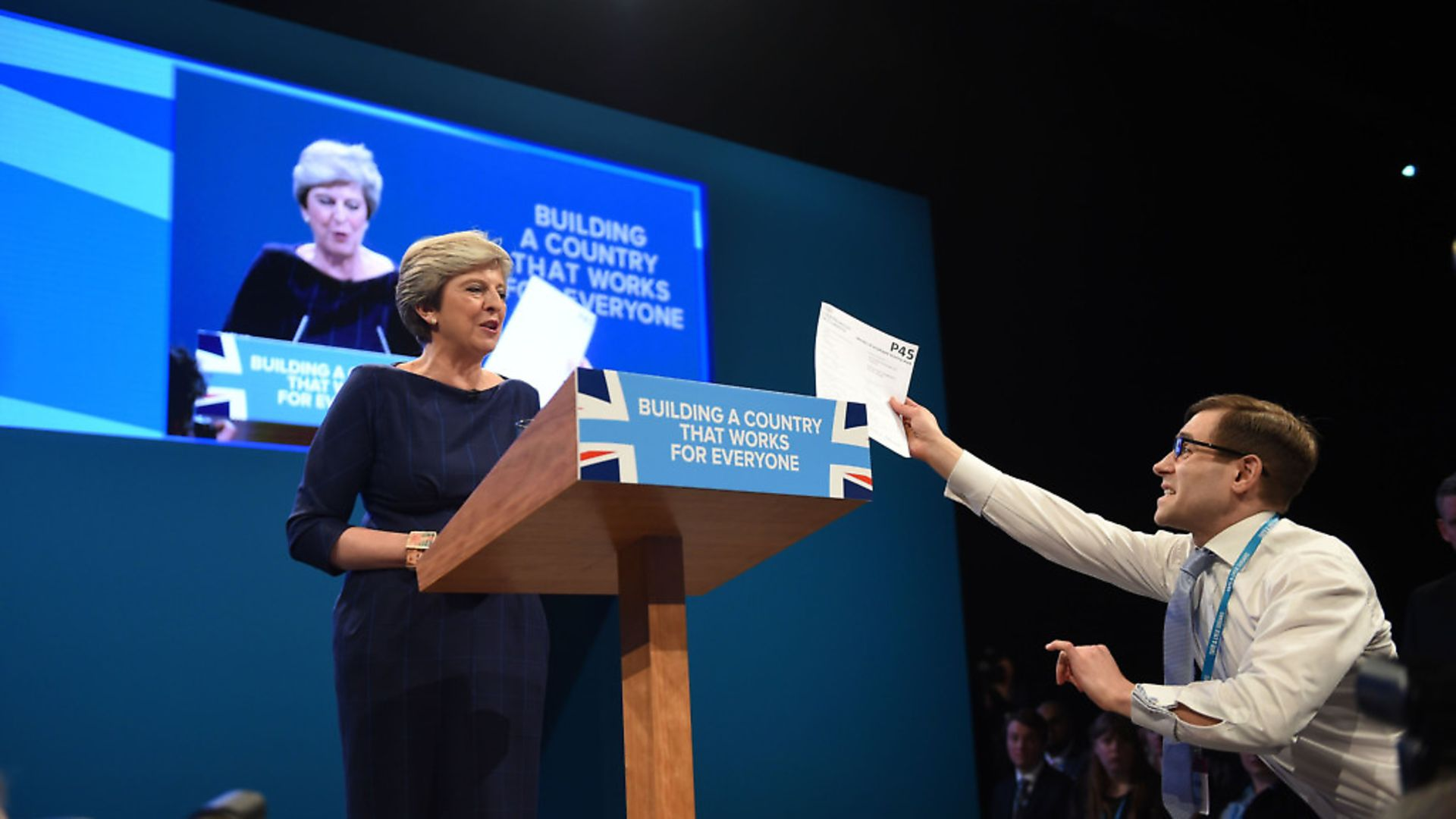 Comedian Simon Brodkin, also known as Lee Nelson confronts Prime Minister Theresa May with her 'P45'. Photograph: Peter Byrne/PA. - Credit: PA Wire/PA Images