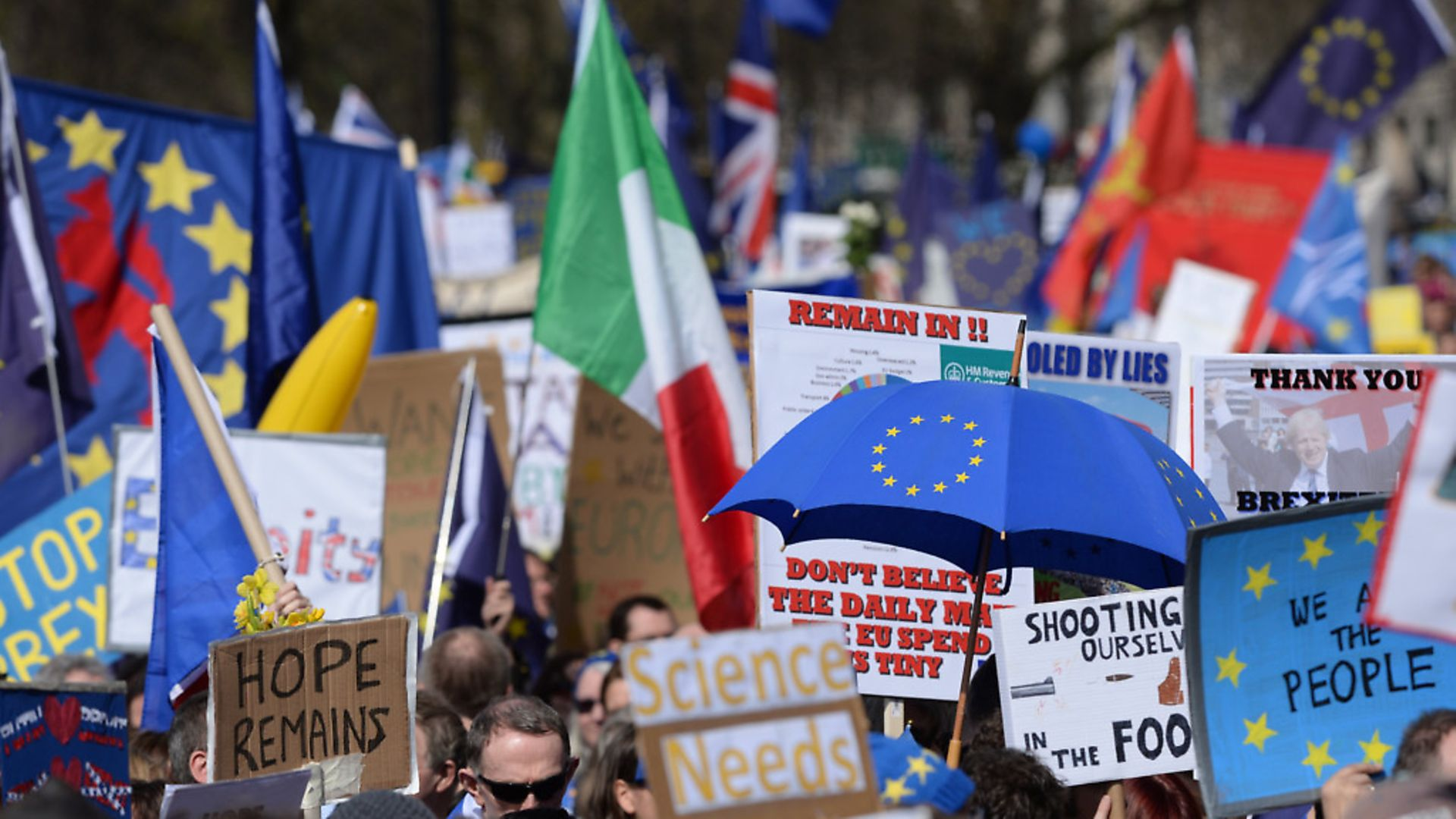 Placards and flags are held by pro-EU protesters. Photograph: Victoria Jones/PA Images. - Credit: PA Wire/PA Images