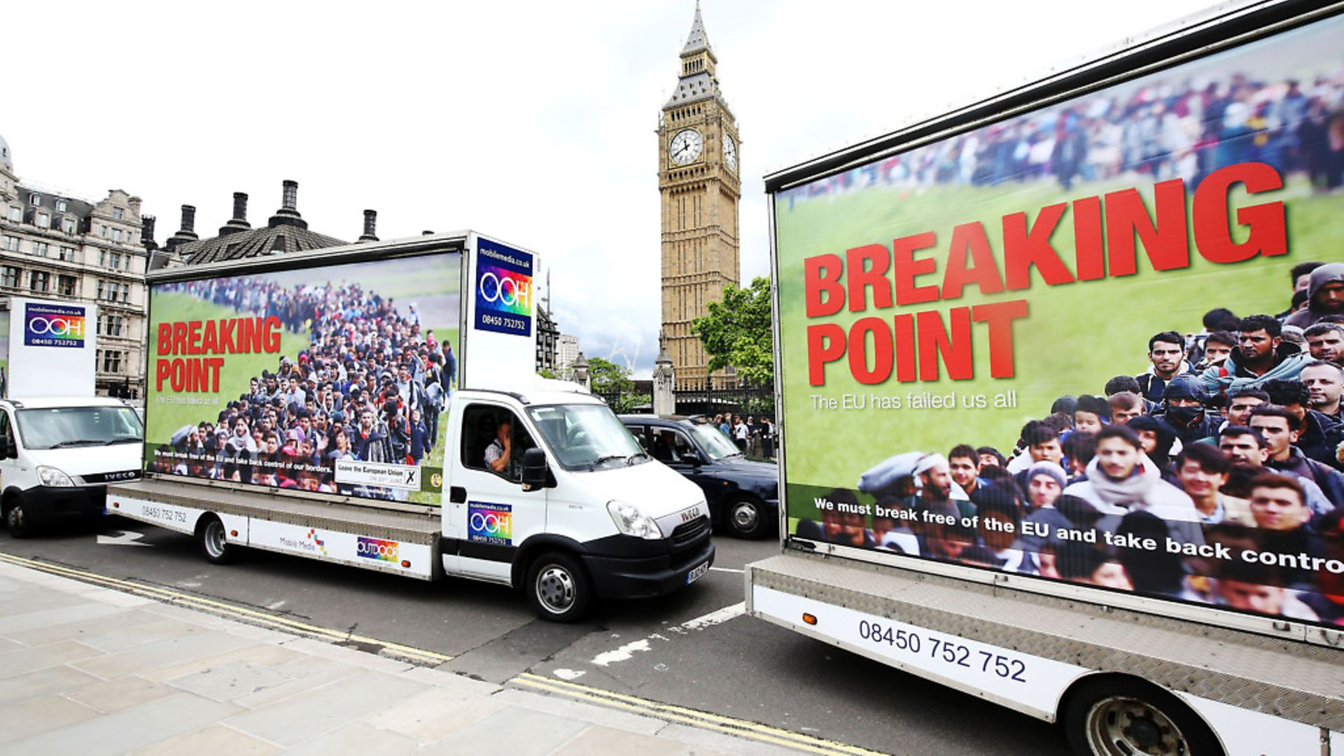 Vans showing the new Ukip EU referendum poster drive past Big Ben in London, for the launch of the poster campaign with Ukip leader Nigel Farage. - Credit: PA Archive/PA Images