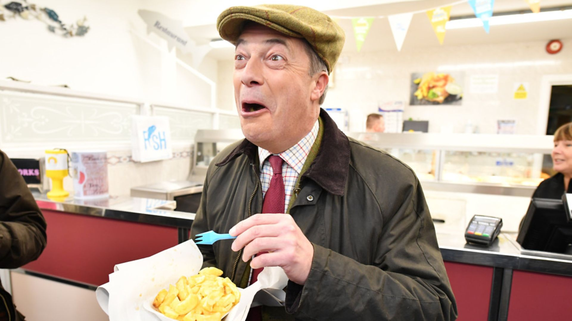 Brexit Party leader Nigel Farage eats fish and chips in Whitehaven. - Credit: Jeff J Mitchell/Getty Images.