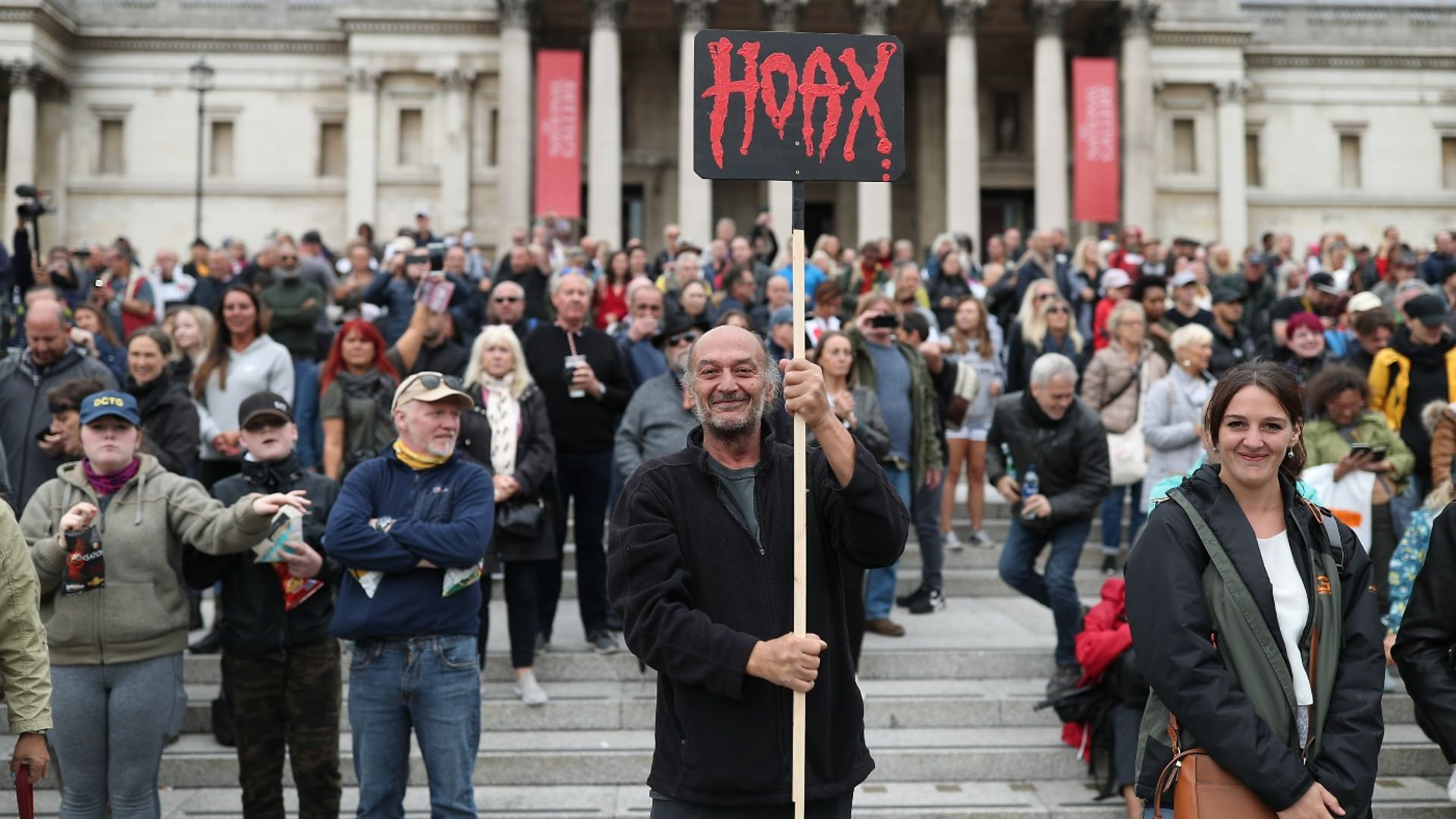 Anti-lockdown protesters, who believe that the coronavirus pandemic is a hoax, gather at the 'Unite For Freedom' rally in Trafalgar Square. - Credit: Yui Mok/PA.