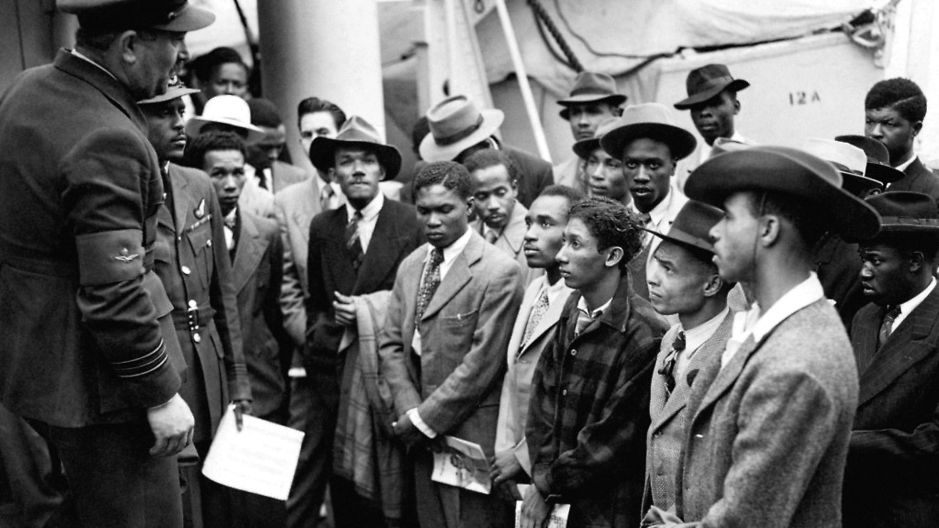 Jamaican immigrants welcomed by RAF officials from the Colonial Office after the ex-troopship HMT 'Empire Windrush' landed them at Tilbury. Photo: PA - Credit: PA Archive/PA Images