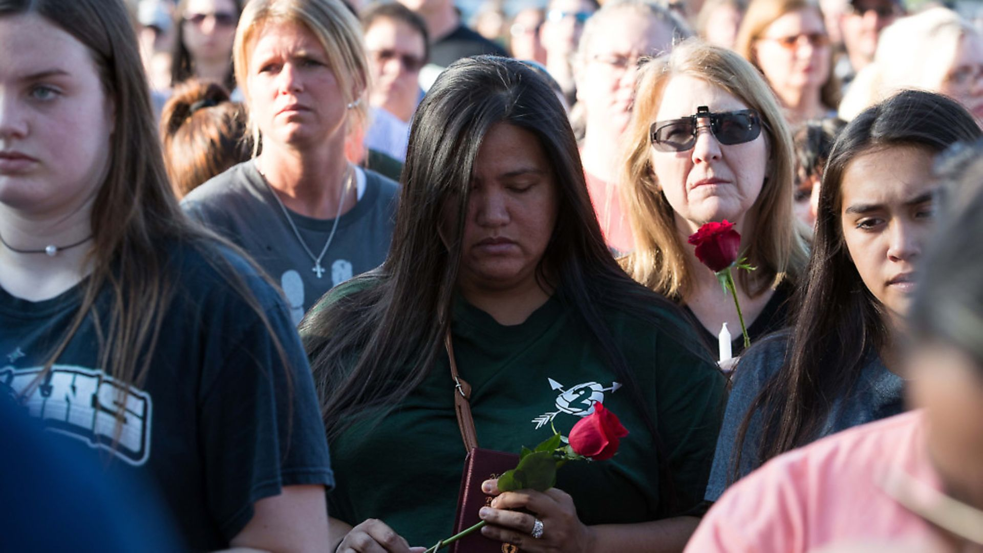 Mourners gather following the shooting that killed 10 at Santa De High School. Picture: PA - Credit: SIPA USA/PA Images