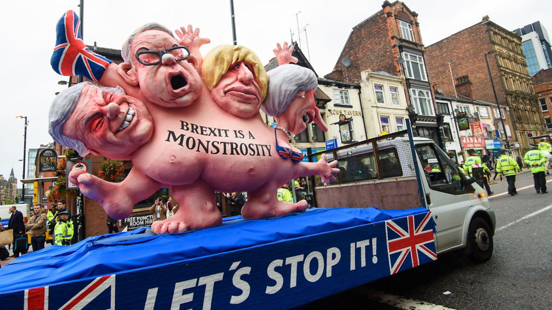 A float satirising Boris Johnson, Theresa May, David Davis and Liam Fox. photograph: Matt Crossick/EMPICS Entertainment. - Credit: Empics Entertainment