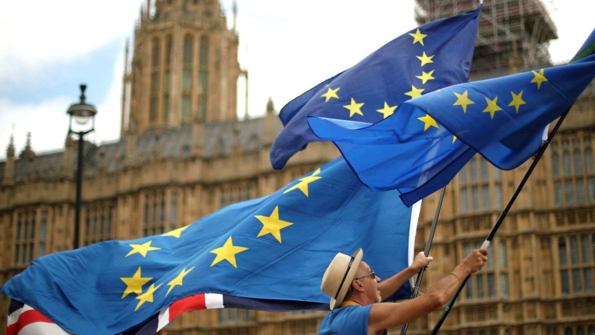 Anti-Brexit demonstrators wave European and Union flags outside the Houses of Parliament in London - Credit: PA Wire/PA Images