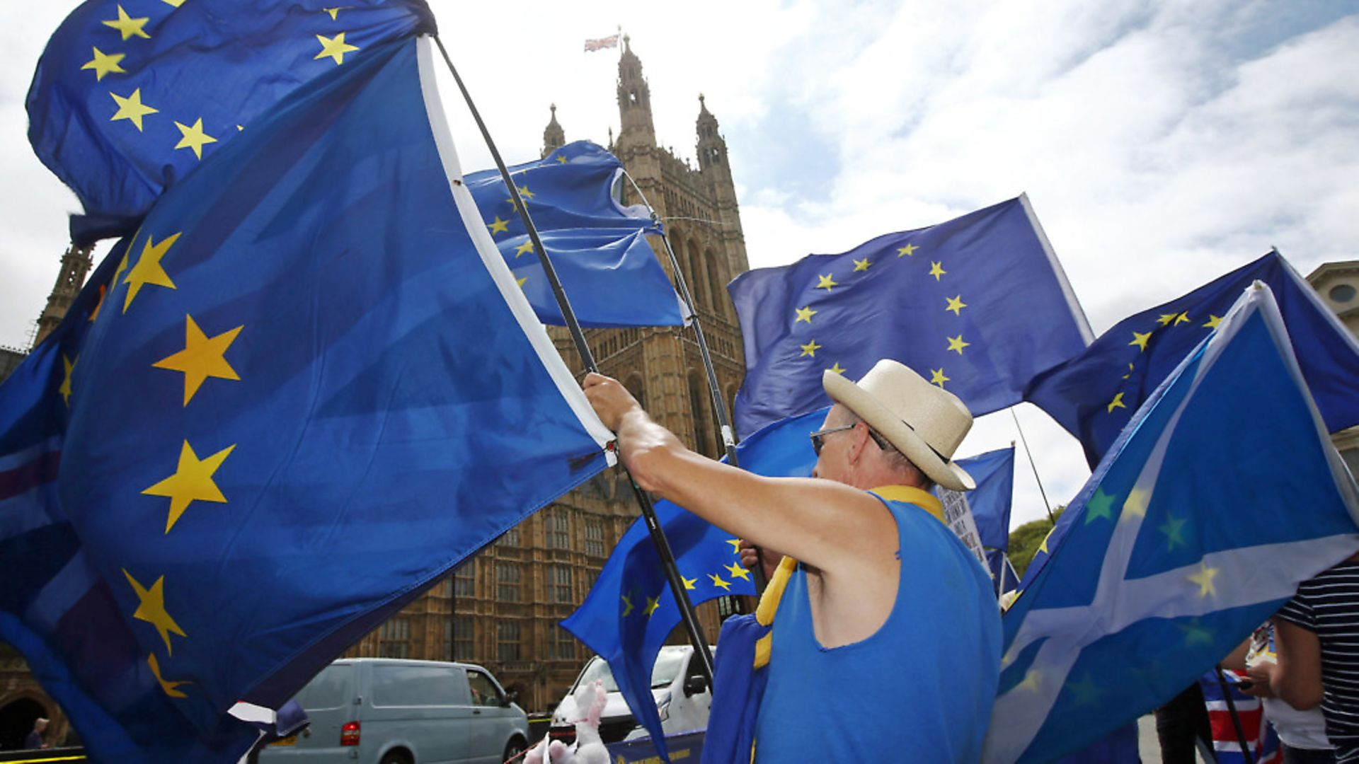Anti-Brexit demonstrators campaign opposite the Houses of Parliament in London. Photograph: Yui Mok/PA Wire. - Credit: PA