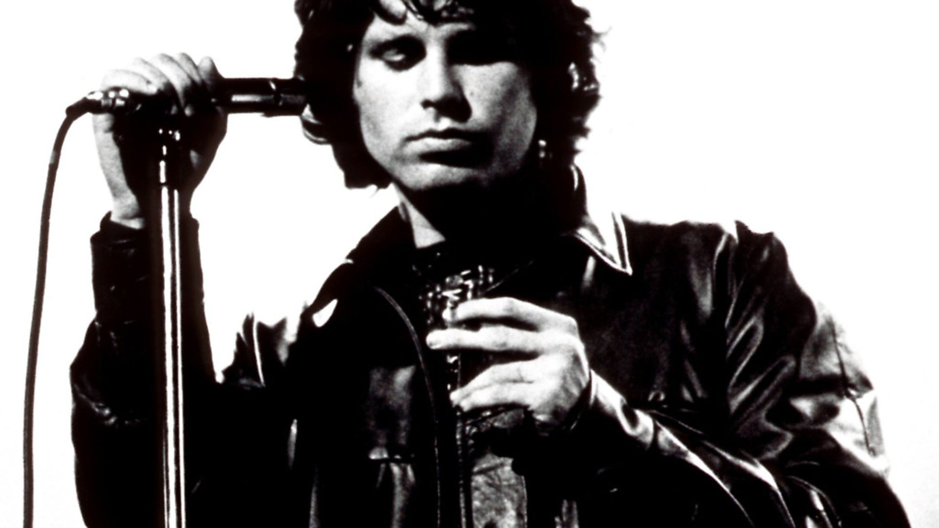 The Doors frontman Jim Morrison performing on stage in 1967. Picture: PA - Credit: EMPICS Entertainment