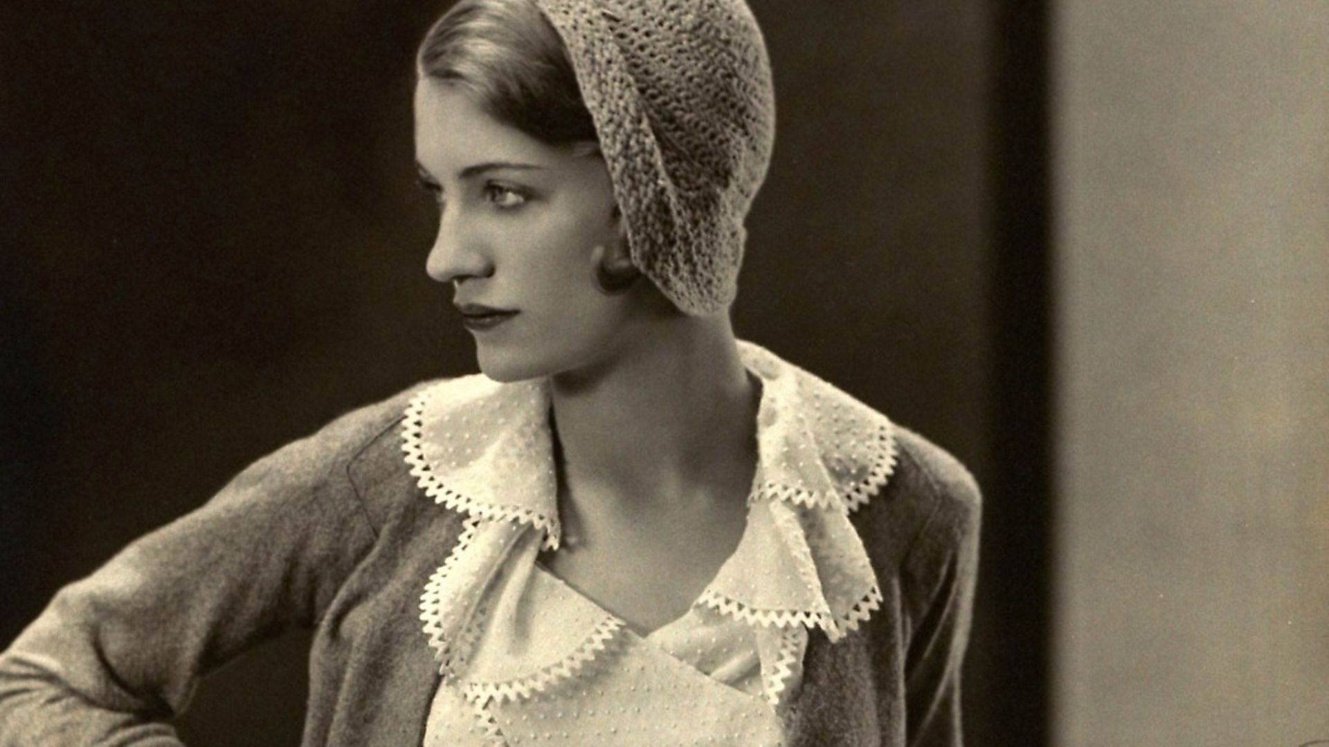 Lee Miller models a  Mirande suit with gloves and crocheted hat. (Photo by�George Hoyningen-Huene/Cond� Nast via Getty Images) - Credit: Cond� Nast via Getty Images
