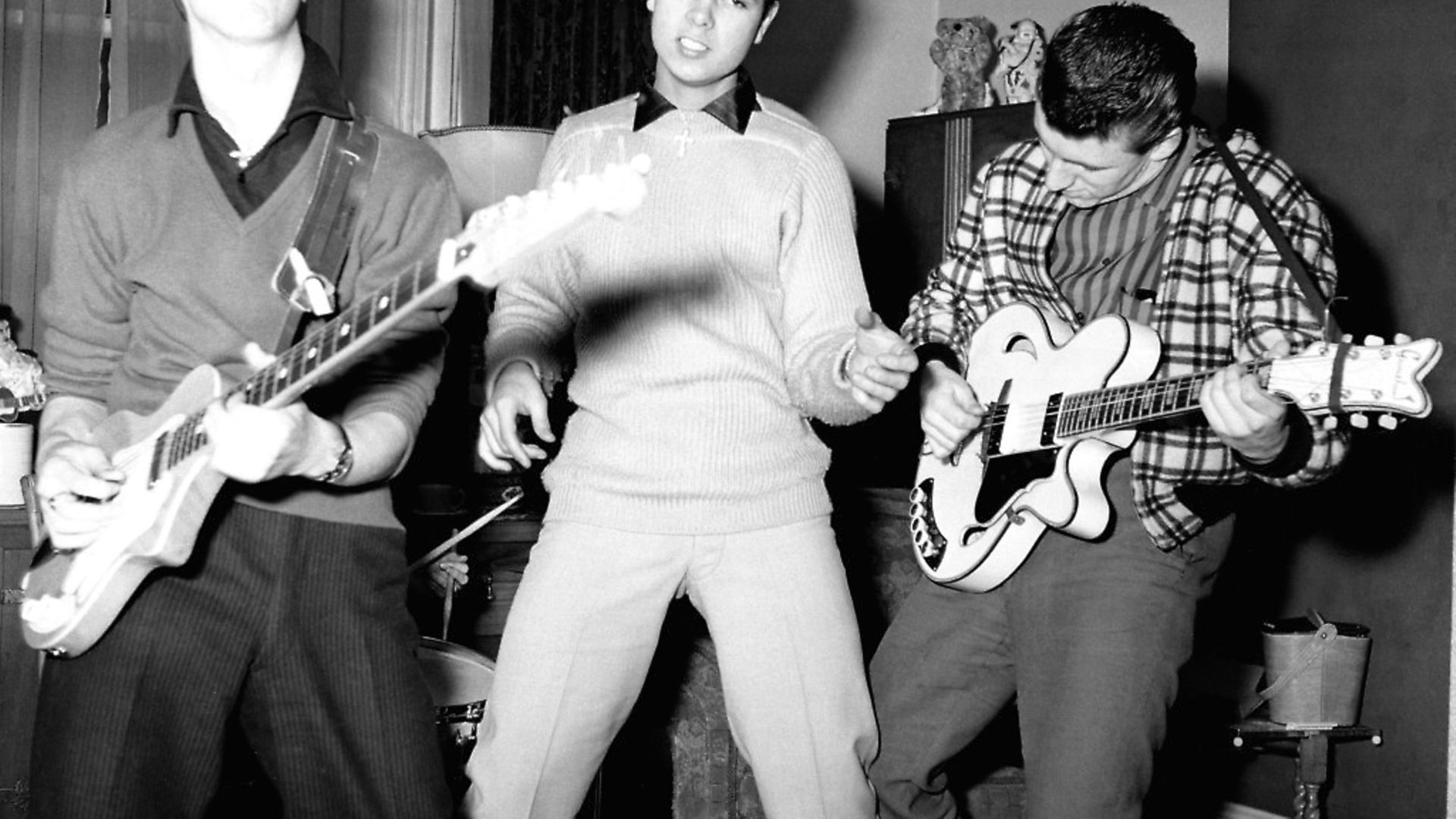 UNITED KINGDOM - JANUARY 01:  Photo of Cliff RICHARD and SHADOWS; posed with The Shadows (when they were called The Drifters) - L-R: Hank Marvin, Cliff Richard, Bruce Welch - c.1959  (Photo by Beverly Lebarrow/Redferns) - Credit: Redferns