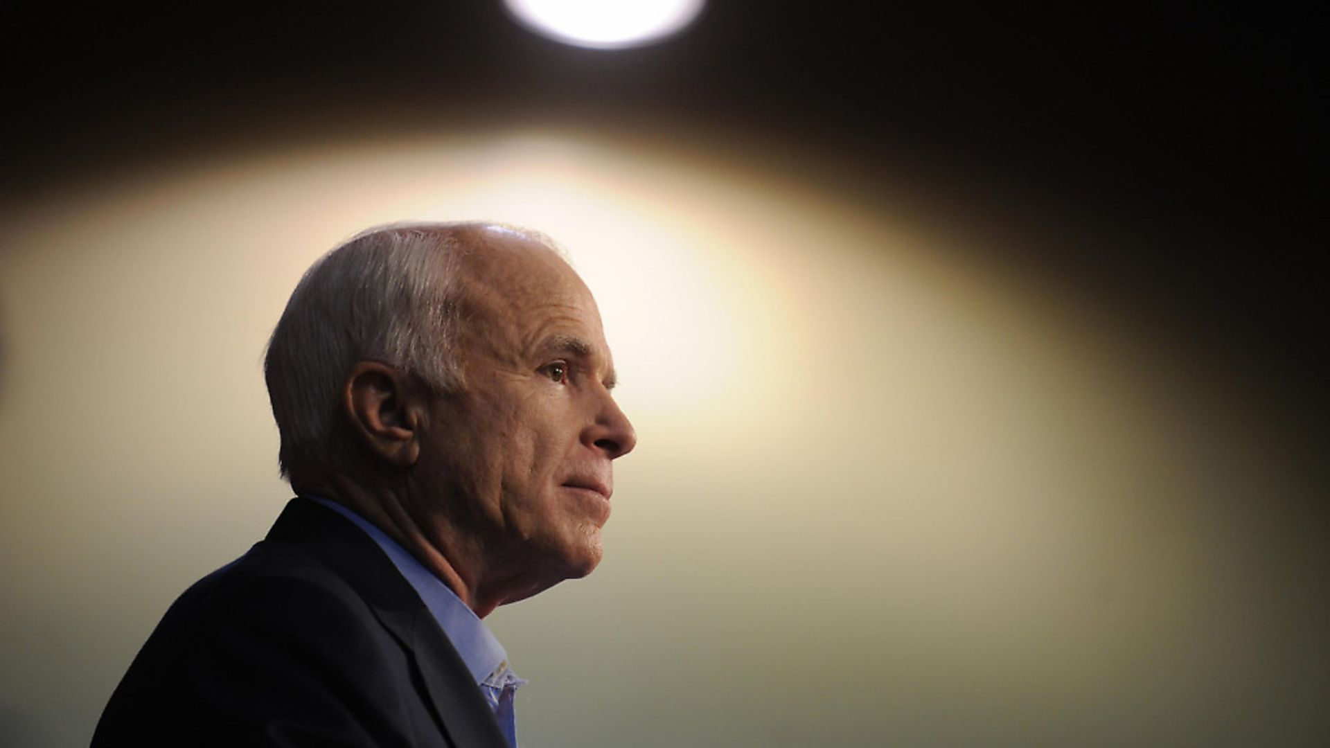 """Republican presidential candidate John McCain pauses during his speech at a """"Joe the Plumber"""" campaign rally in Sarasota, Florida on October 23, 2008.  McCain is on a six-stop, one-day """"Joe the Plumber"""" bus tour across central Florida to meet with small business owners.   AFP PHOTO Robyn BECK (Photo credit should read ROBYN BECK/AFP/Getty Images) - Credit: AFP/Getty Images"""