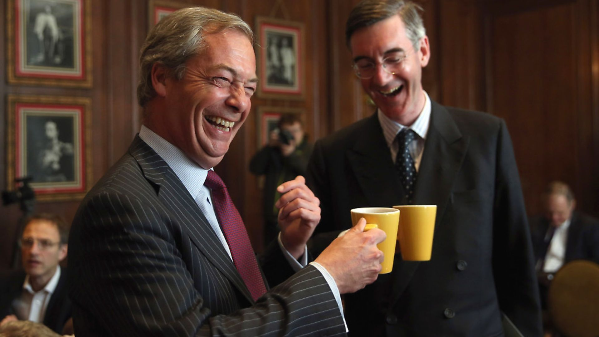 Cheers! Nigel Farage and Jacob Rees-Mogg. Photo: Dan Kitwood/Getty Images. - Credit: Getty Images