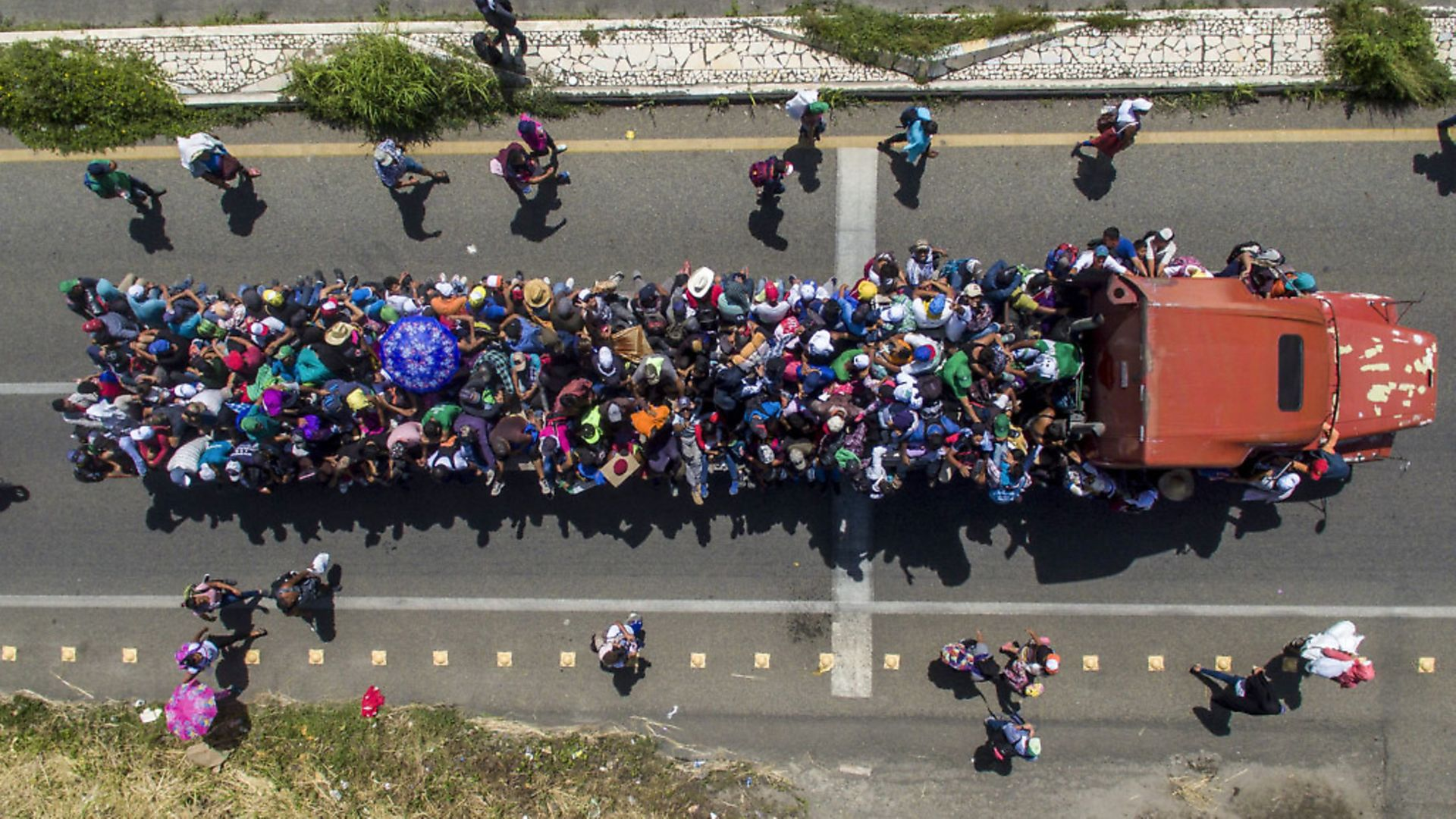 Aerial view of Honduran migrants onboard a truck as they take part in a caravan heading to the US, in the outskirts of Tapachula, Mexico. Picture by PEDRO PARDO/AFP - Credit: AFP/Getty Images