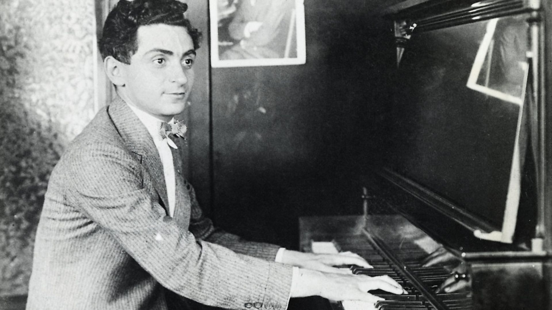 Composer Irving Berlin is shown seated at a piano, playing. Picture: George Rinhart/Corbis via Getty Images - Credit: Corbis via Getty Images