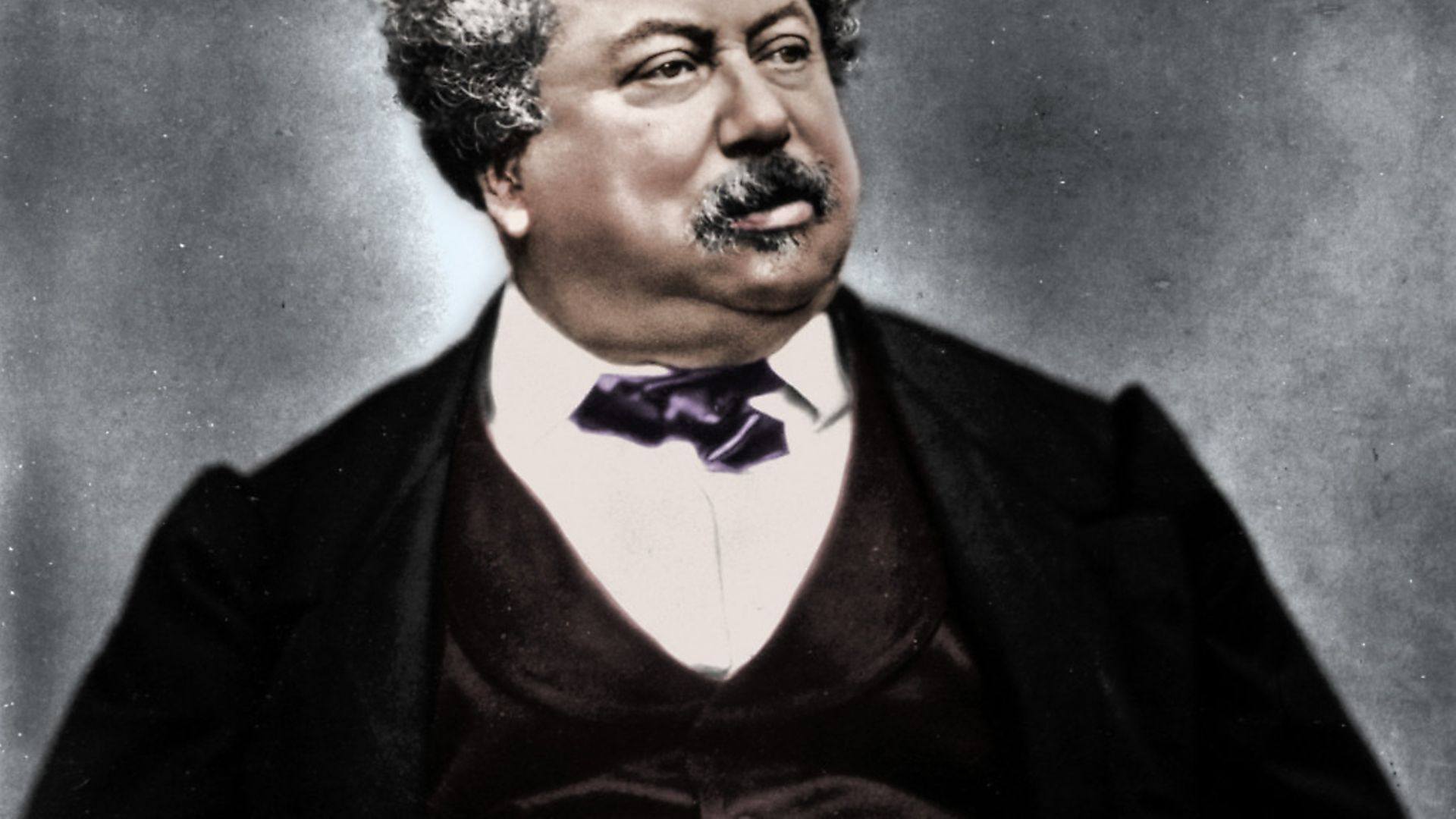 Alexandre Dumas the Elder, French novelist and playwright, c1850-1870. Dumas (1802-1870) was the author of popular historical adventure classics including The Man in the Iron Mask, The Three Musketeers and The Count of Monte Cristo. (Colorised black and white print). Artist Etienne Carjat.. (Photo by The Print Collector/Getty Images) - Credit: Getty Images