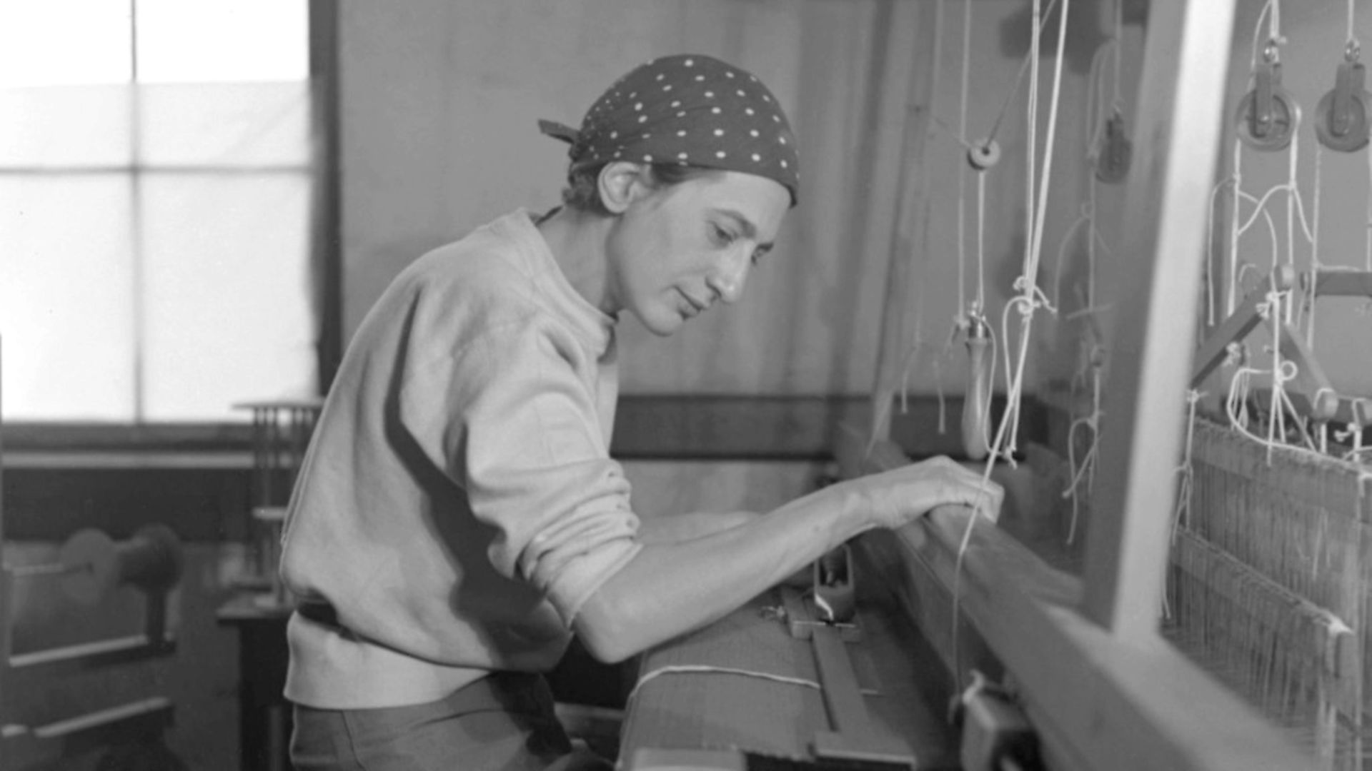 anni albers in her weaving studio at black mountain college, 1937. Photo: The Josef and Anni Albers Foundation - Credit: Archant
