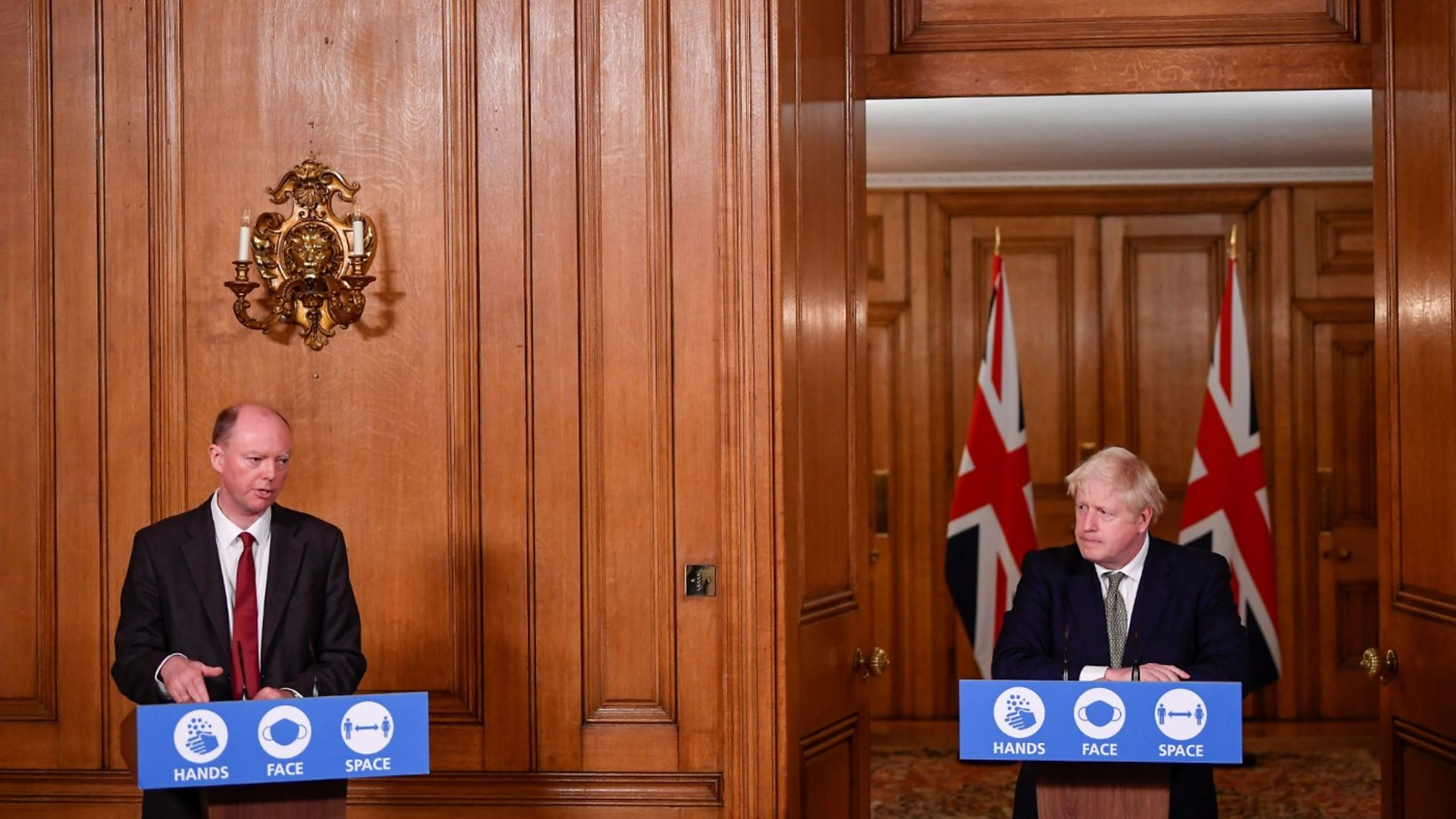 Chris Whitty and Boris Johnson at a Downing Street press conference - Credit: PA Wire/PA Images