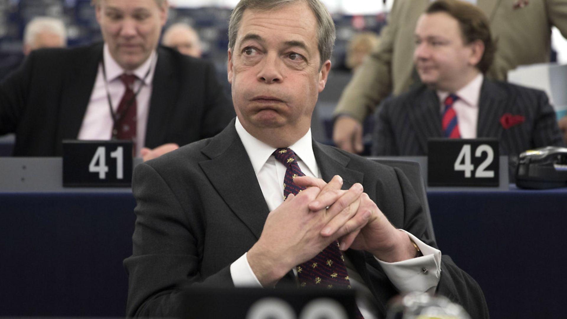Nigel Farage listens to a debate in the European parliament. Photograph: AP Photo/Jean-Francois Badias. - Credit: AP
