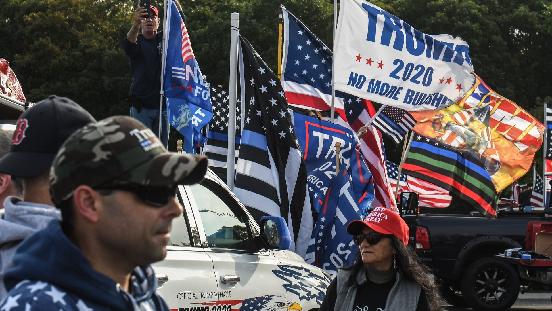 People participate in a pro-Trump rally on October 11, 2020 in Ronkonkoma, New York.  (Photo by Stephanie Keith/Getty Images) - Credit: Getty Images