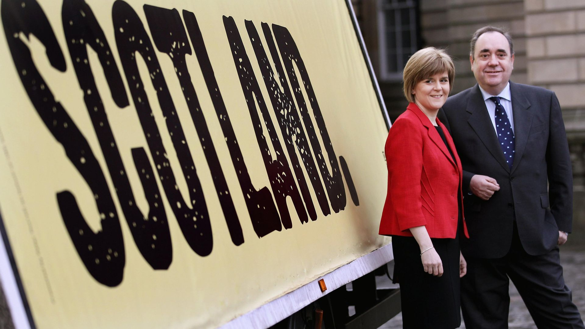 SPLIT: Former Scotland first minister Alex Salmond and then-deputy and successor as first minister Nicola Sturgeon pose together during a SNP campaign poster launch in 2011 (Photo: Getty Images) - Credit: Getty Images