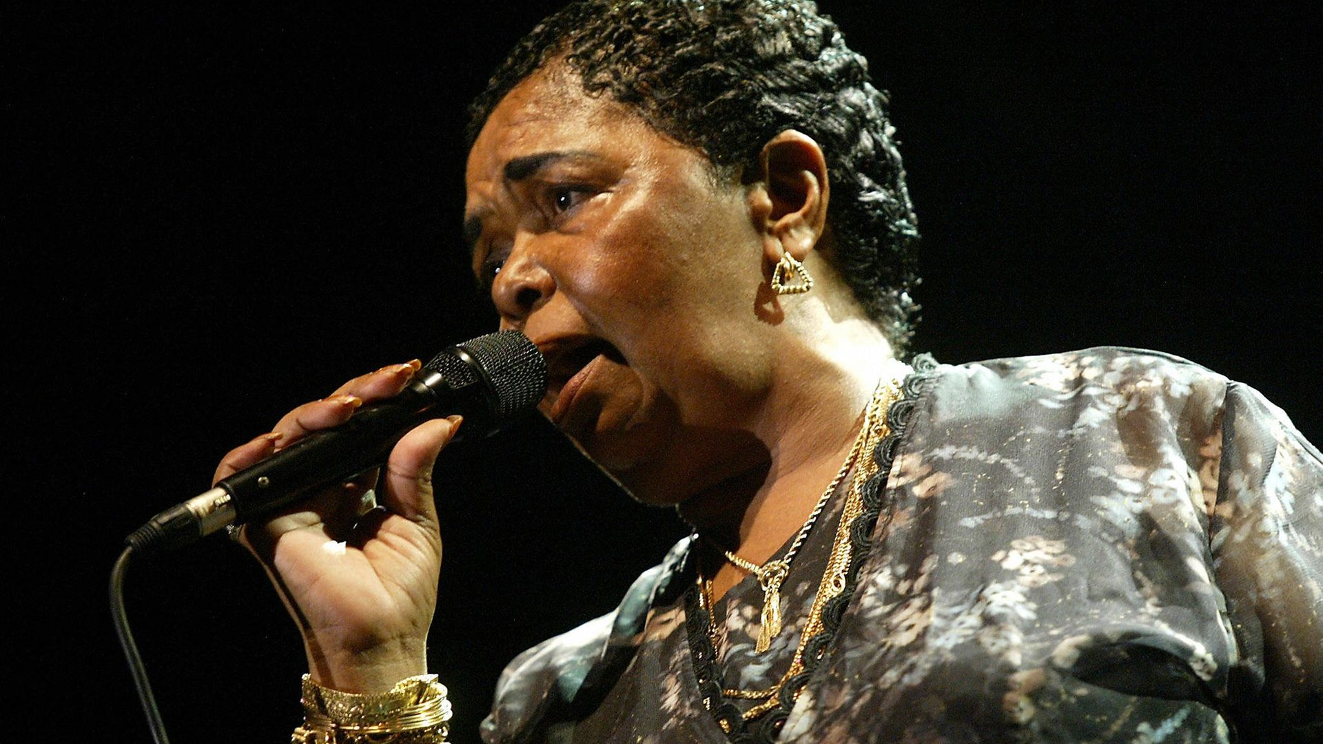 Singer Cesaria Evora of Cape Verde performs during her concert in Nicosia late 13 July 2004 - Credit: AFP via Getty Images