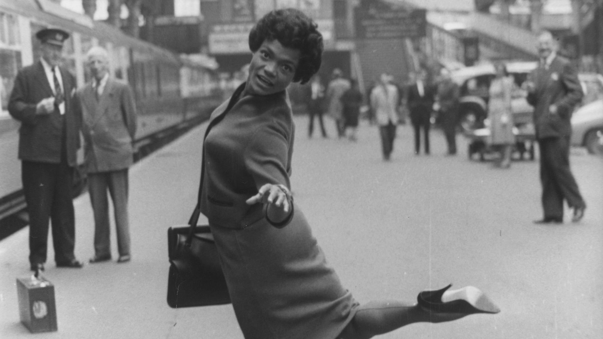 American jazz singer Eartha Kitt at Paddington Railway station before the start of a two month cabaret tour - Credit: Getty Images