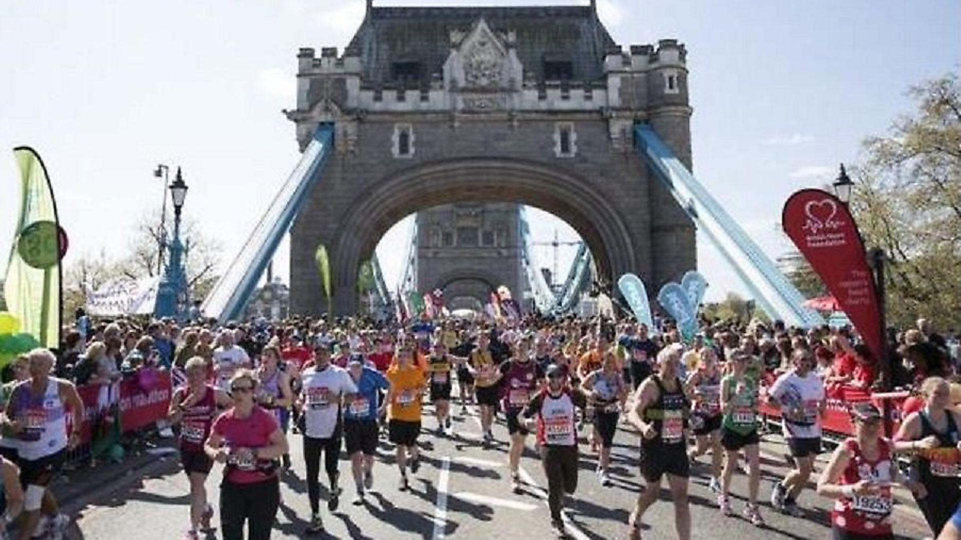 London Marathon runners set to cross Tower Bridge like those last year. Picture source: LBTH - Credit: LBTH