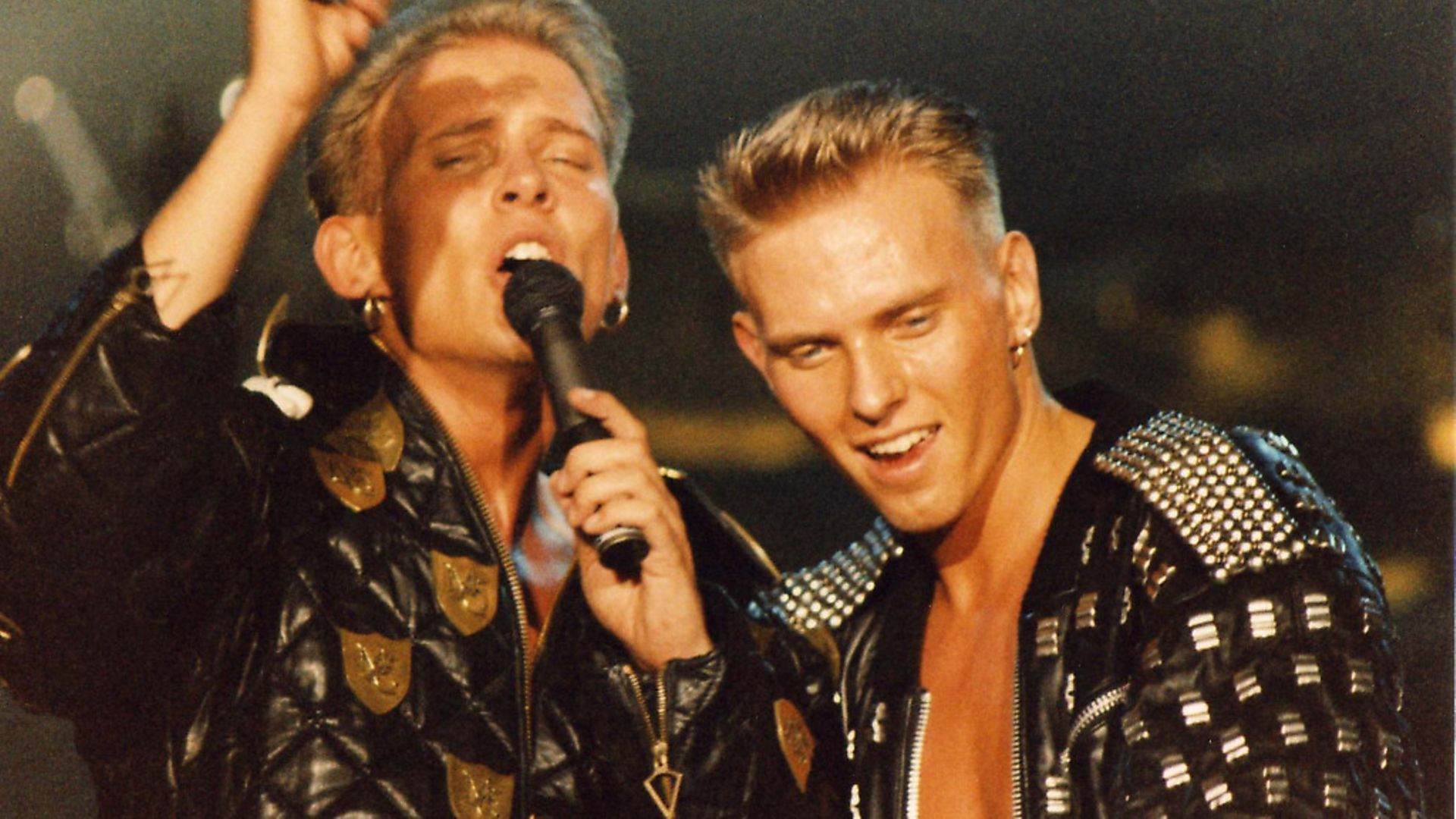 Matt and Luke Goss of Bros perform on stage on 'The Big Push' tour at Wembley Arena on December 28th, 1988 in London, England. (Photo by Peter Still/Redferns) - Credit: Redferns