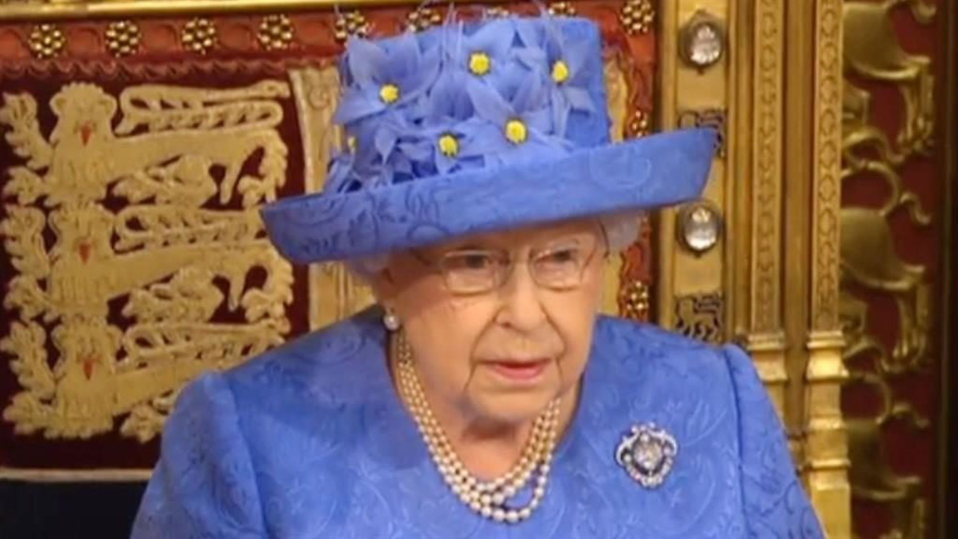 The Queen in blue and yellow at the state opening of parliament in 2017. Photograph: PA. - Credit: Archant