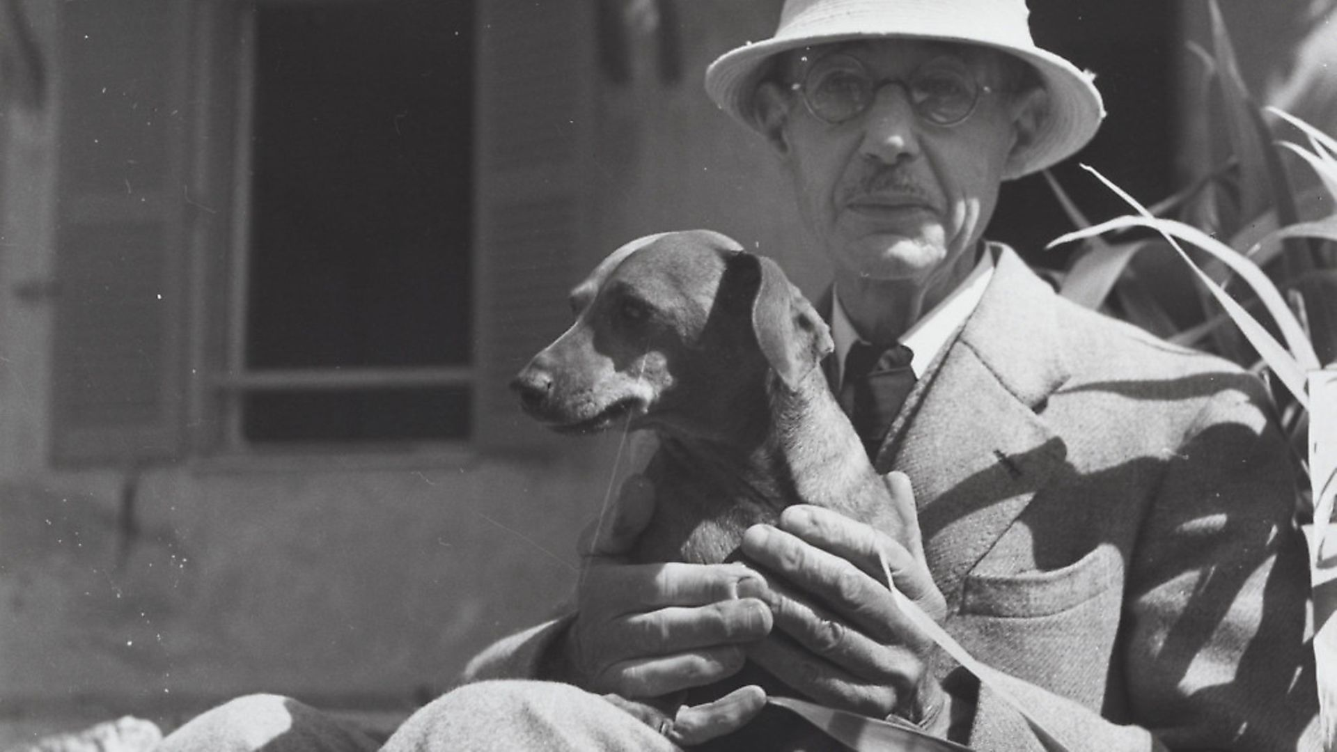 Artist Pierre Bonnard with daschund Poucette in 1941. Picture: Andre Ostier - Credit: Archant