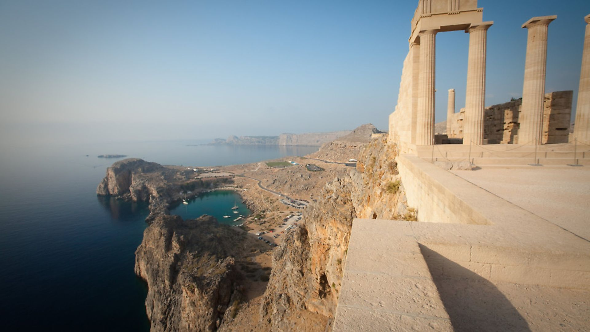 he English word apostrophe comes from a Greek term meaning turning away. Acropolis of Lindos, overlooking St. Paul's Bay, Lindos, Rhodes, Greece. - Credit: Getty Images