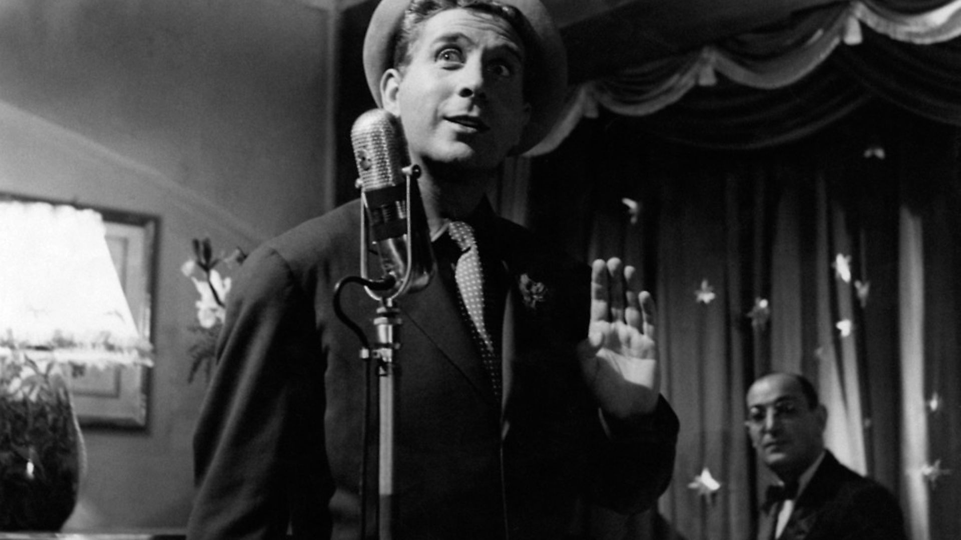 French actor, singer and songwriter Charles Trenet singing in Giovinezza. Italy, 1952 (Photo by Mondadori Portfolio by Getty Images) - Credit: Mondadori via Getty Images