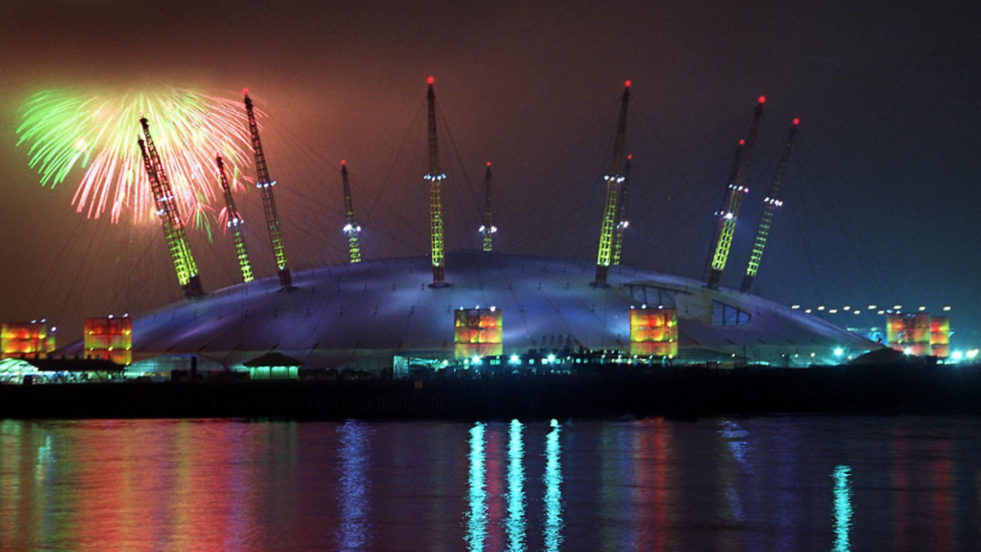 Fireworks light up the sky 01January 2000 on the strike of midnight as low cloud threatens to engulf Britain's flagship millennium dome, now called The O2. Picture: HUGO PHILPOTT/AFP/Getty Images - Credit: AFP/Getty Images
