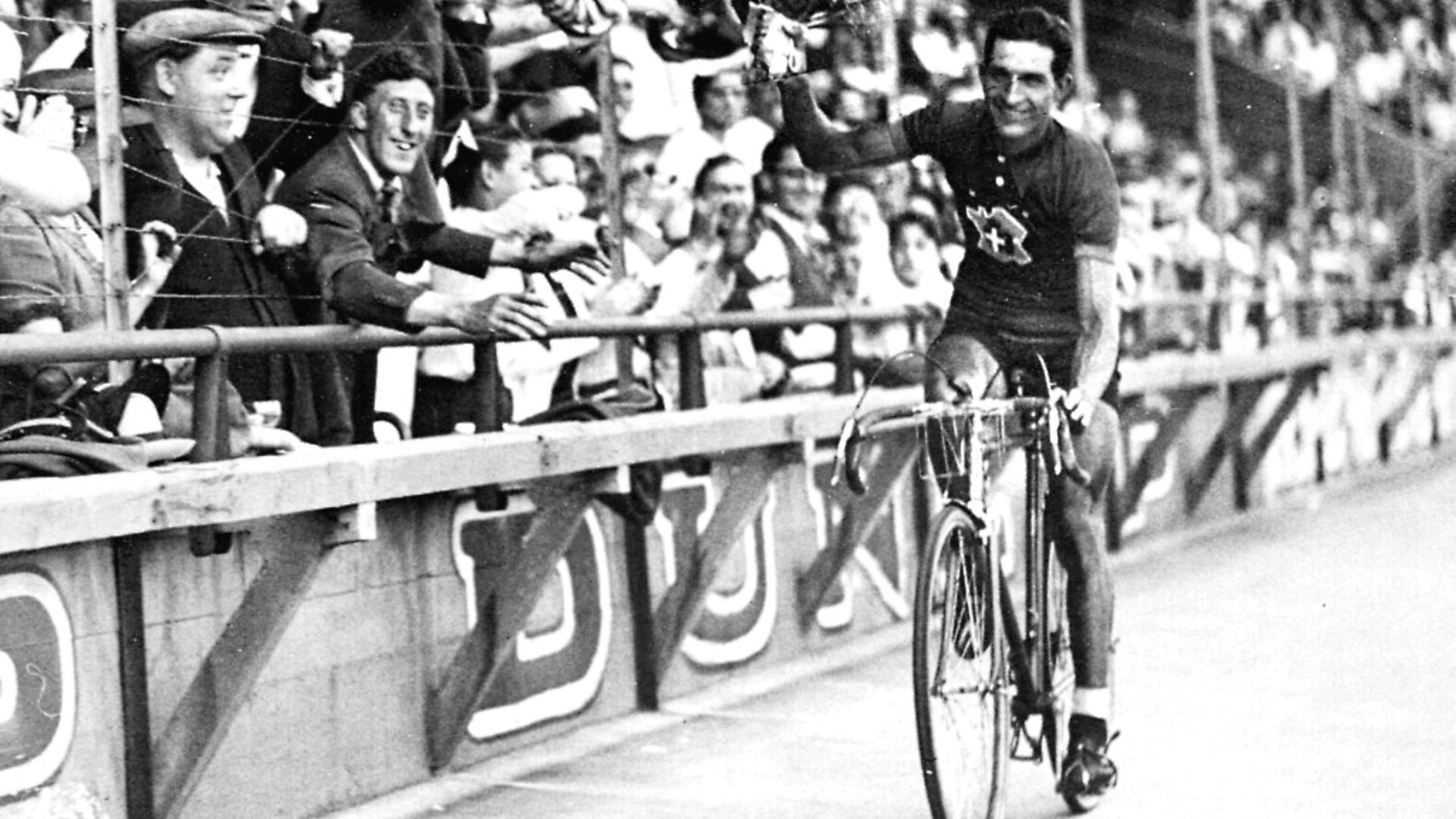 Italian racing cyclist Gino Bartali celebrating his Tour de France victory, 31st July 1938. Photo by Roger Viollet/Getty Images - Credit: Roger Viollet/Getty Images
