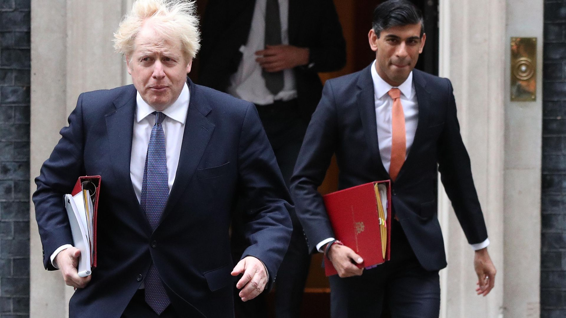 Prime minister Boris Johnson (left) and chancellor Rishi Sunak leave 10 Downing Street London, ahead of a Cabinet meeting at the Foreign and Commonwealth Office. - Credit: PA