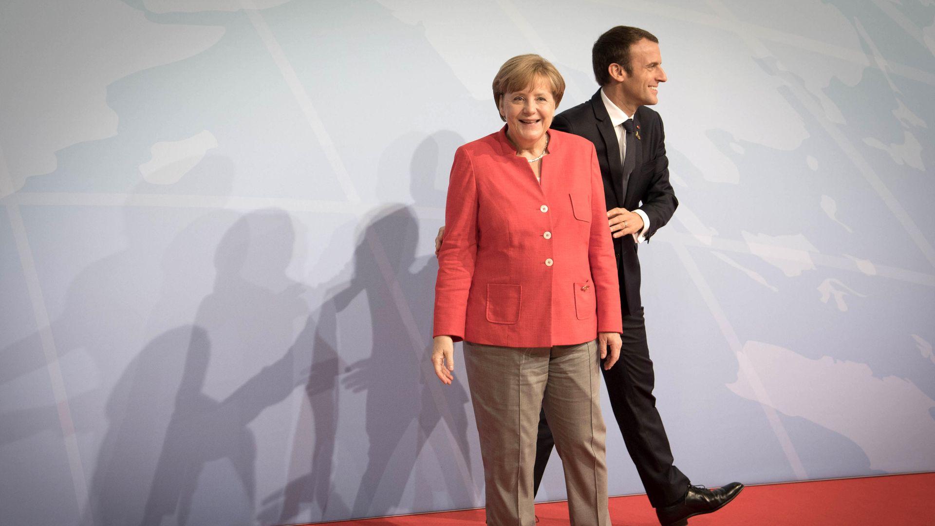 German Chancellor Angela Merkel and French President Emmanuel Macron - Credit: PA