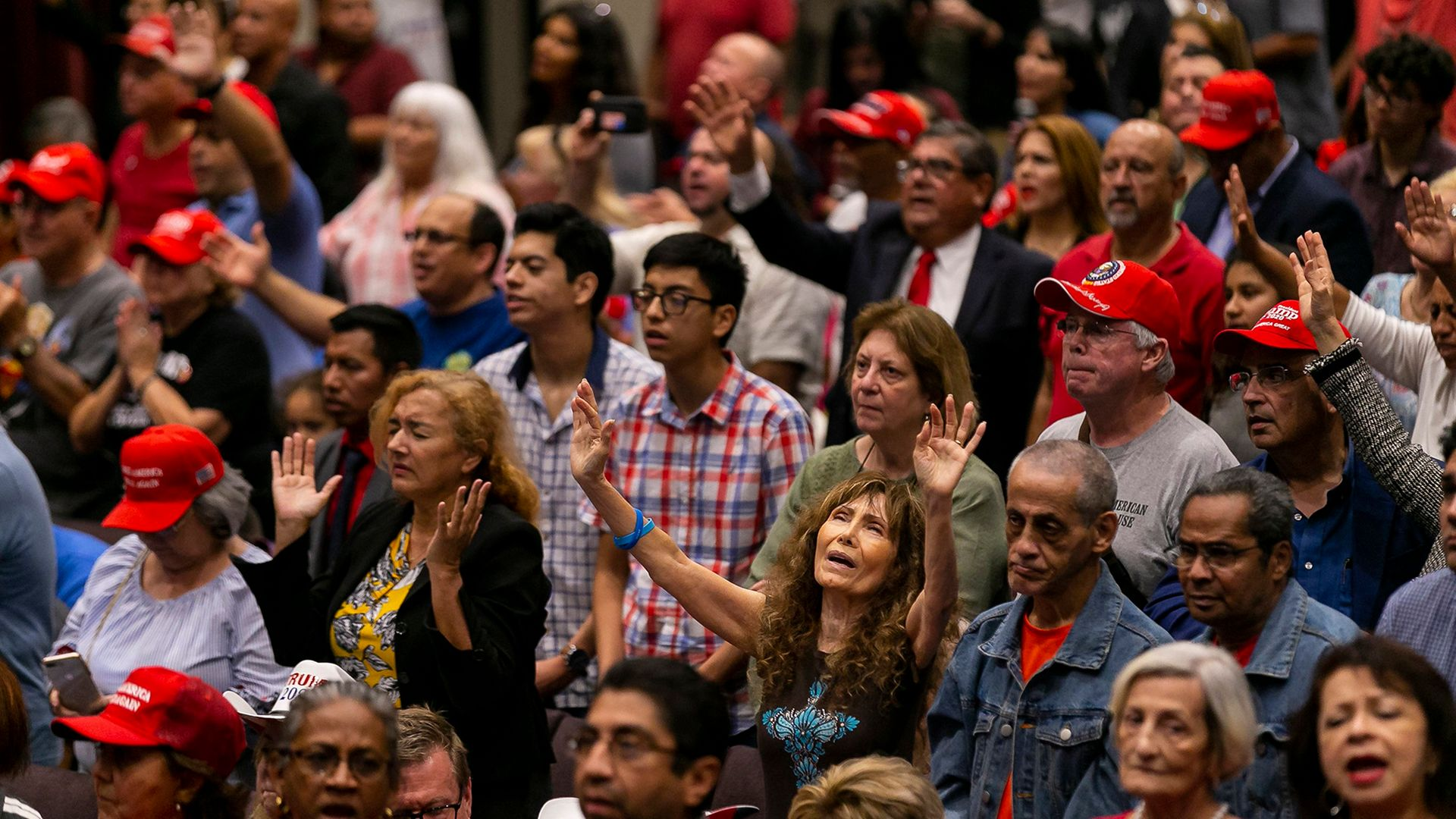 """Attendees pray before President Donald Trump speaks at an """";Evangelicals for Trump"""" campaign rally in Miami. - Credit: Miami Herald/Getty Images"""