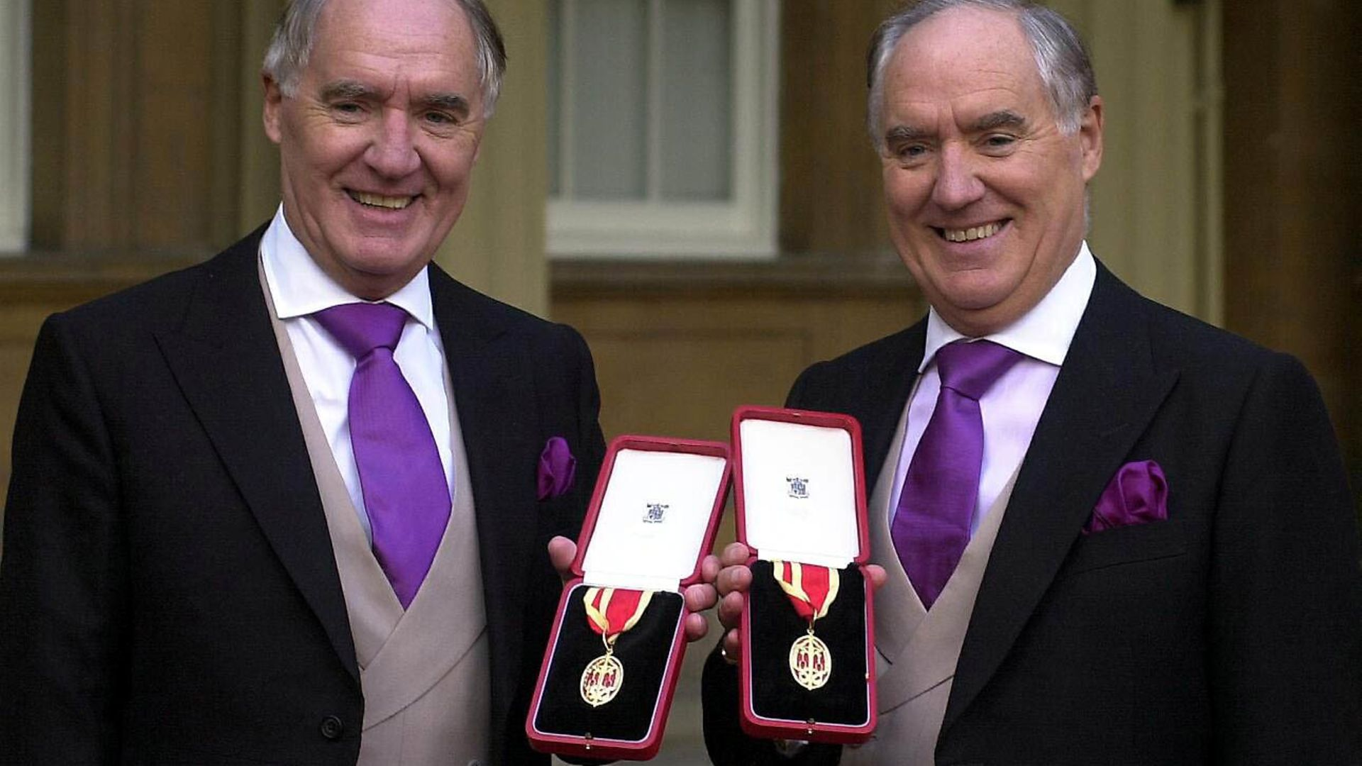 Multi-millionaires Sir David Barclay (left) and his twin brother Sir Frederick after receiving their knighthoods from the Queen at Buckingham Palace. - Credit: PA