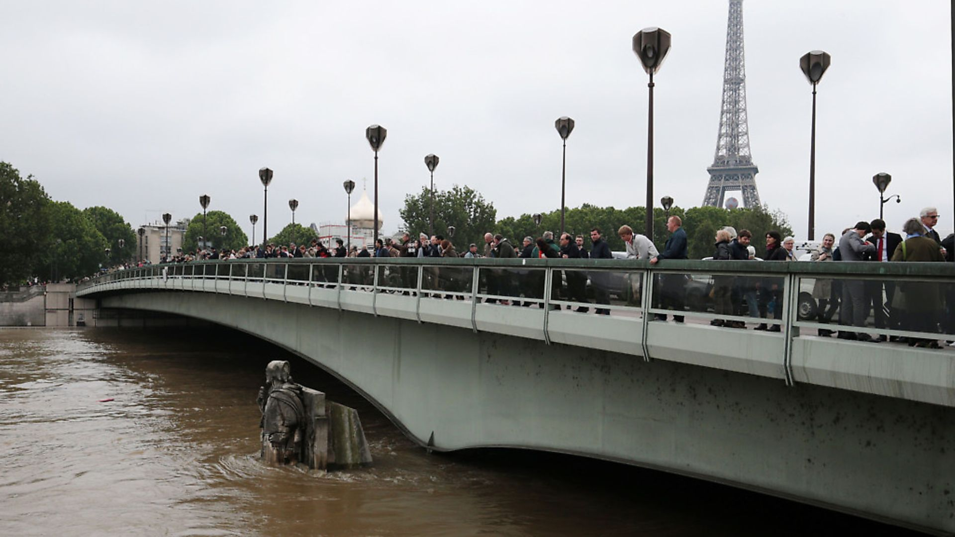 People look at waters of the river Seine rising on the statue of the Zouave at the Alma bridge in Paris on June 3, 2016. Photo: JOEL SAGET/AFP/Getty Images - Credit: AFP/Getty Images