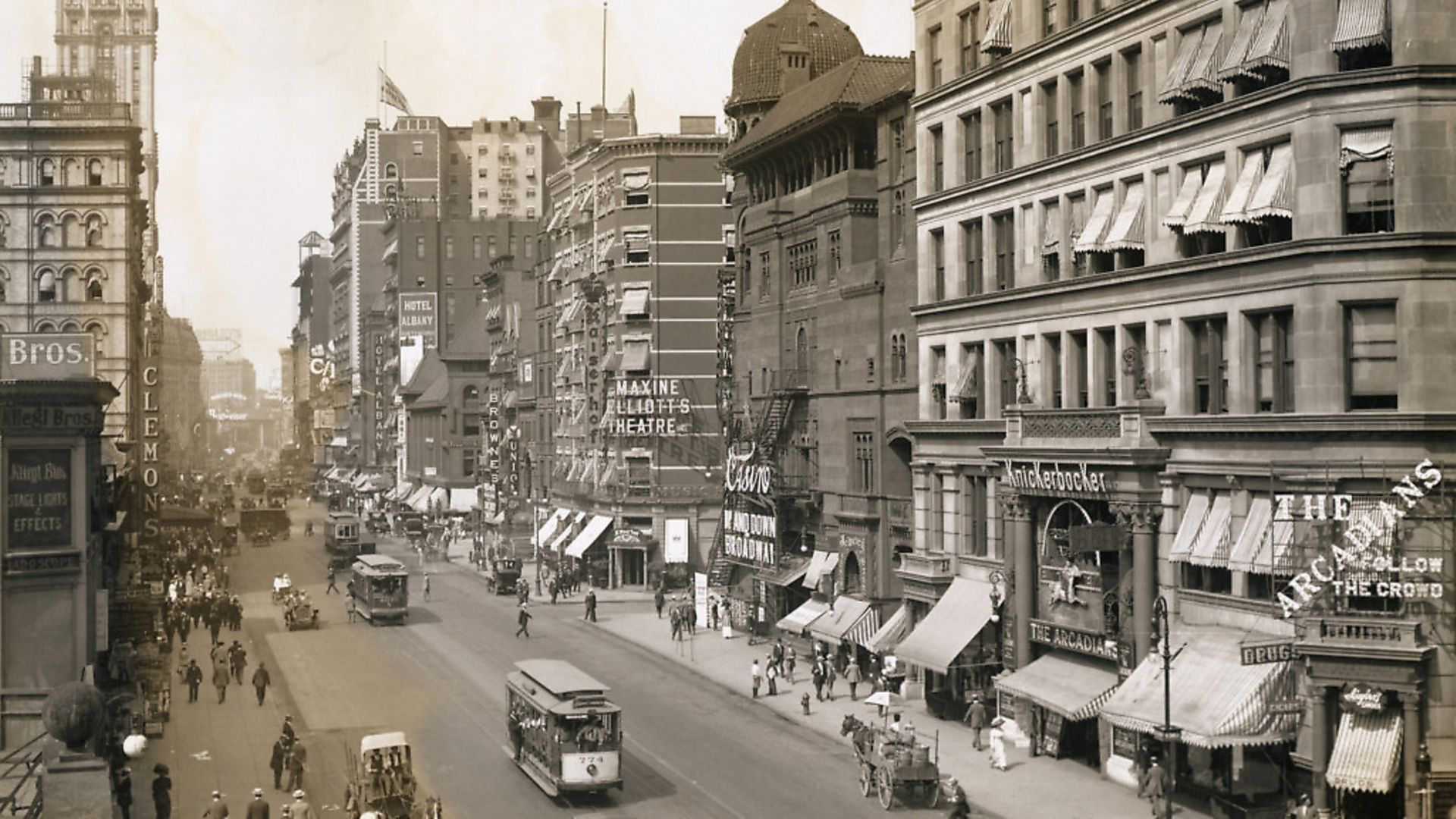 Carriages and Trolleys Along Broadway (Photo by �� Schenectady Museum; Hall of Electrical History Foundation/CORBIS/Corbis via Getty Images) - Credit: Corbis via Getty Images